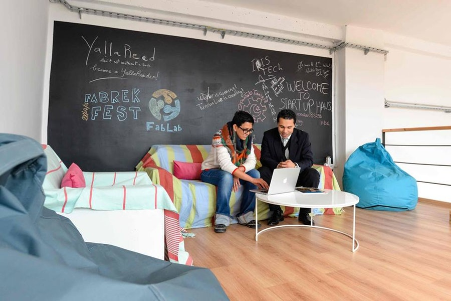 Young Tunisian entrepreneurs chat at a coworking space at Startup Haus in downtown Tunis. (Startup Haus)