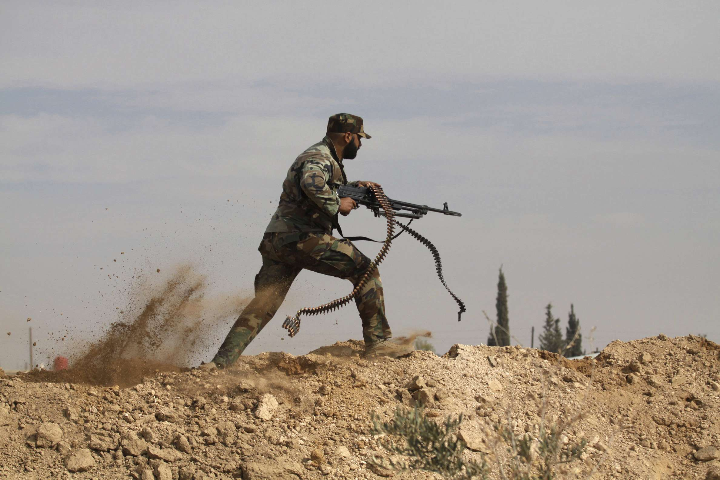 Unwise steps. A file picture shows an Iran-backed Shia fighter clashing with members of the Free Syrian Army rebels in the countryside of Damascus. (AP)