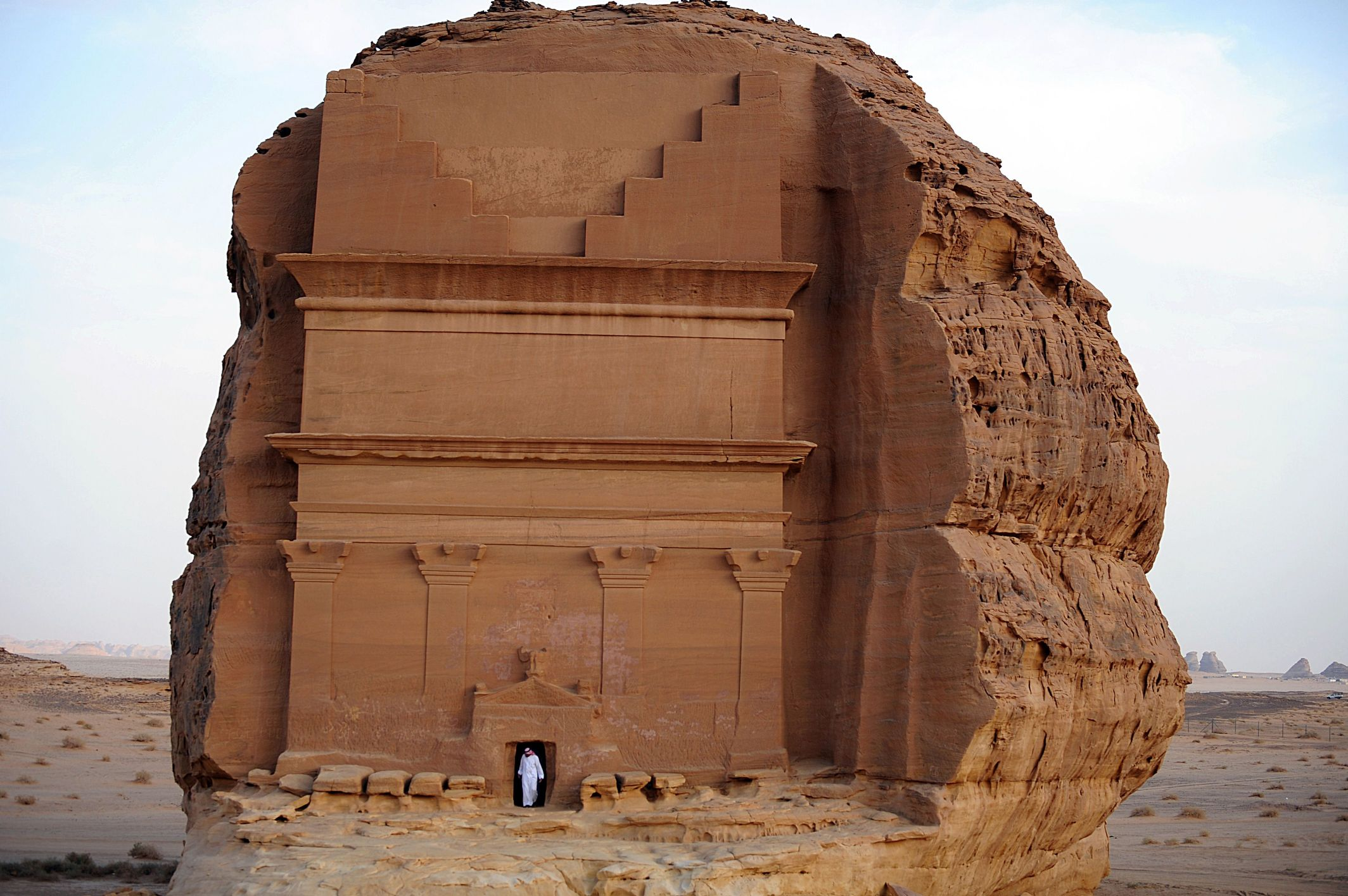 A Saudi man leaves a tomb carved into rose-coloured sandstone mountains in the archaeological site of Al Hijr. (AFP)