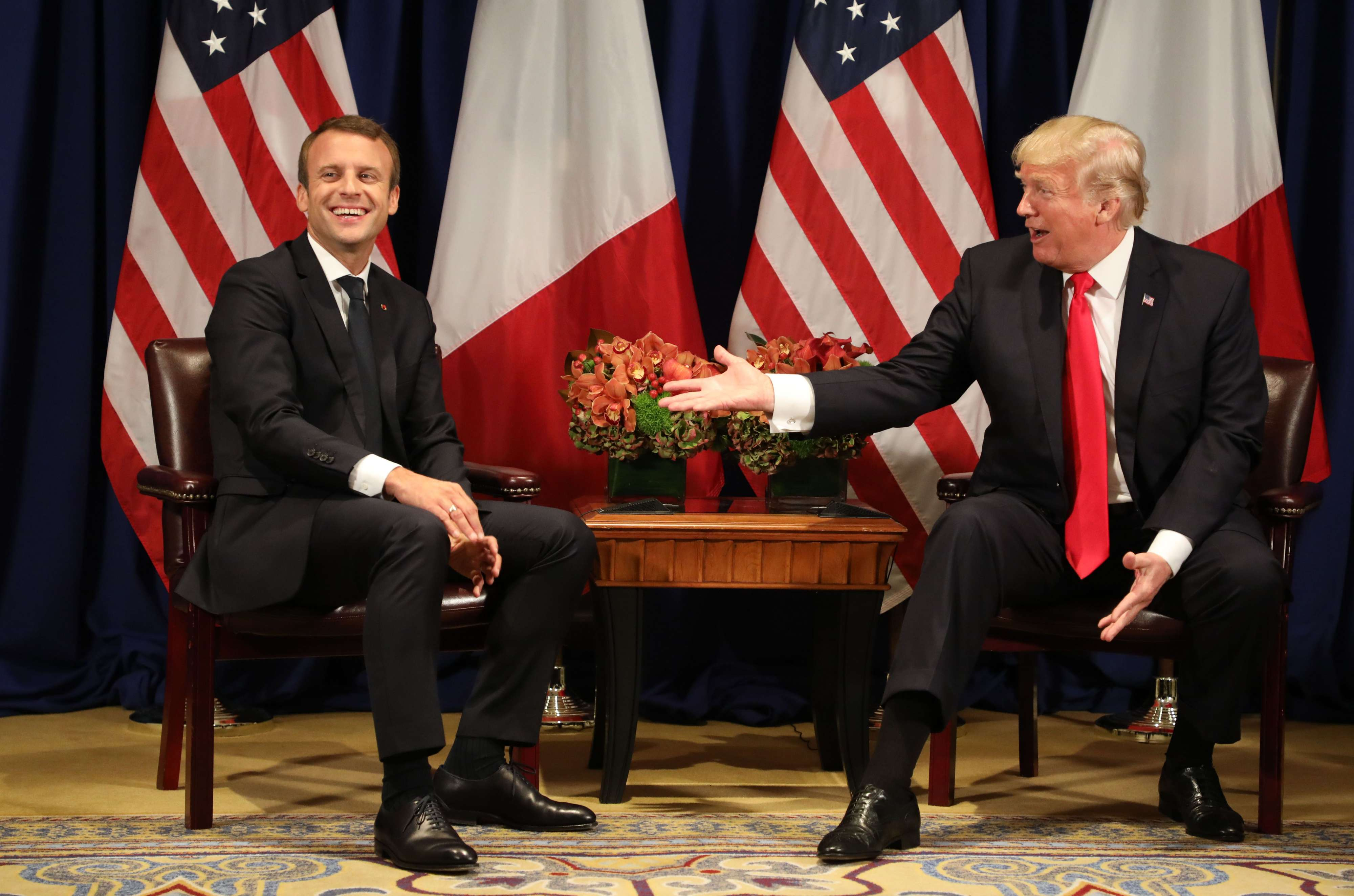 A 2017 file picture shows French President Emmanuel Macron (L) laughing with US President Donald Trump before a meeting at the Palace Hotel in New York. (AFP)