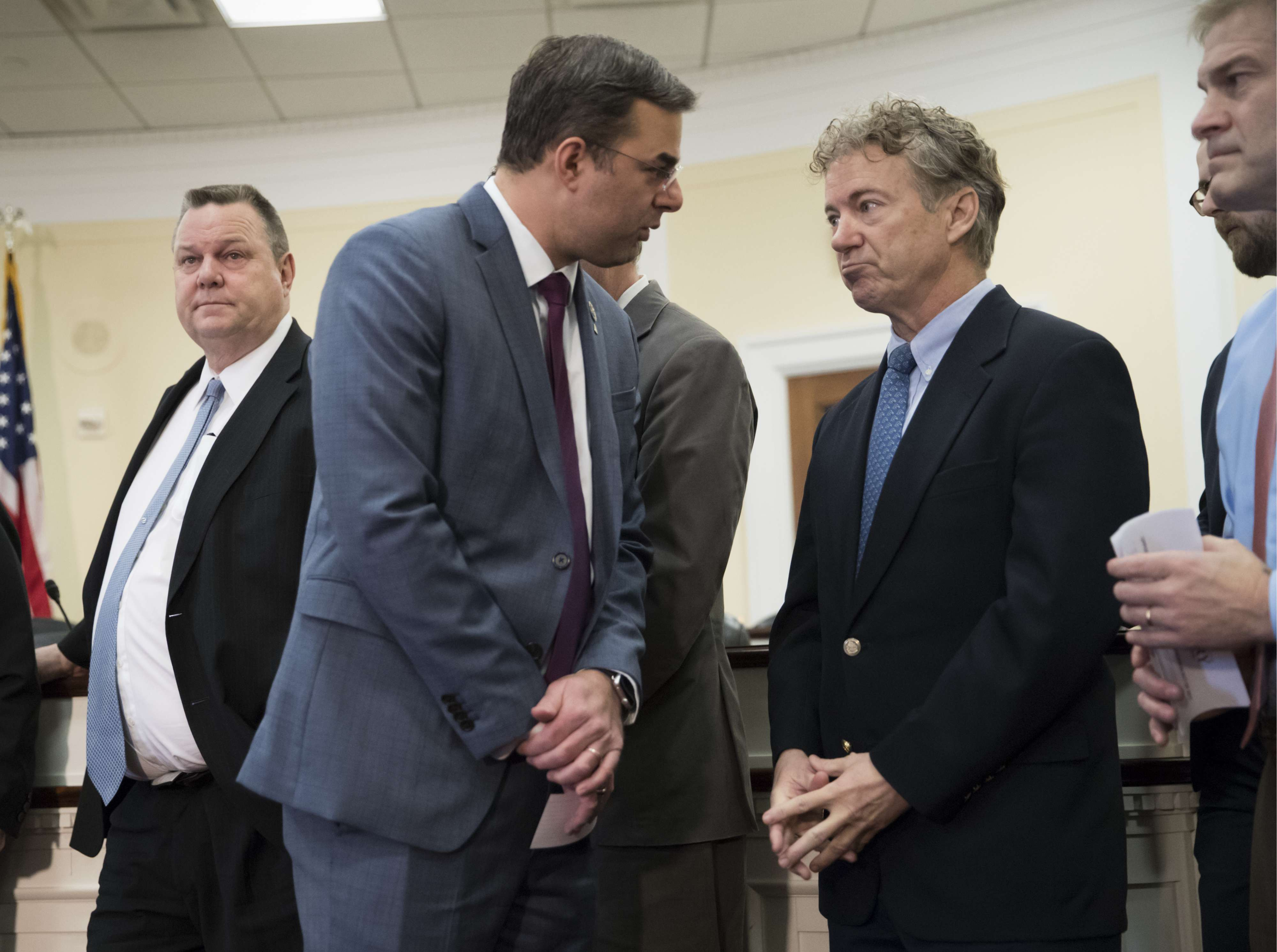 US Representative Justin Amash (C-L) confers with Senator Rand Paul ahead of a news conference in Washington, last January. (AP)