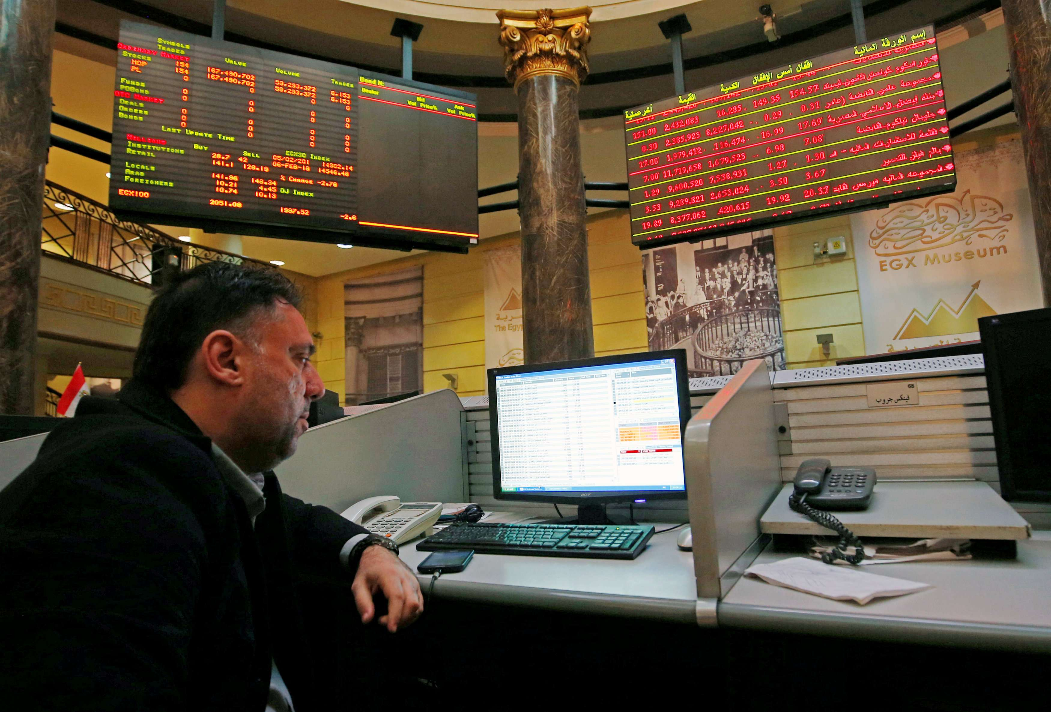 A trader works at the Egyptian stock market in Cairo. (Reuters)