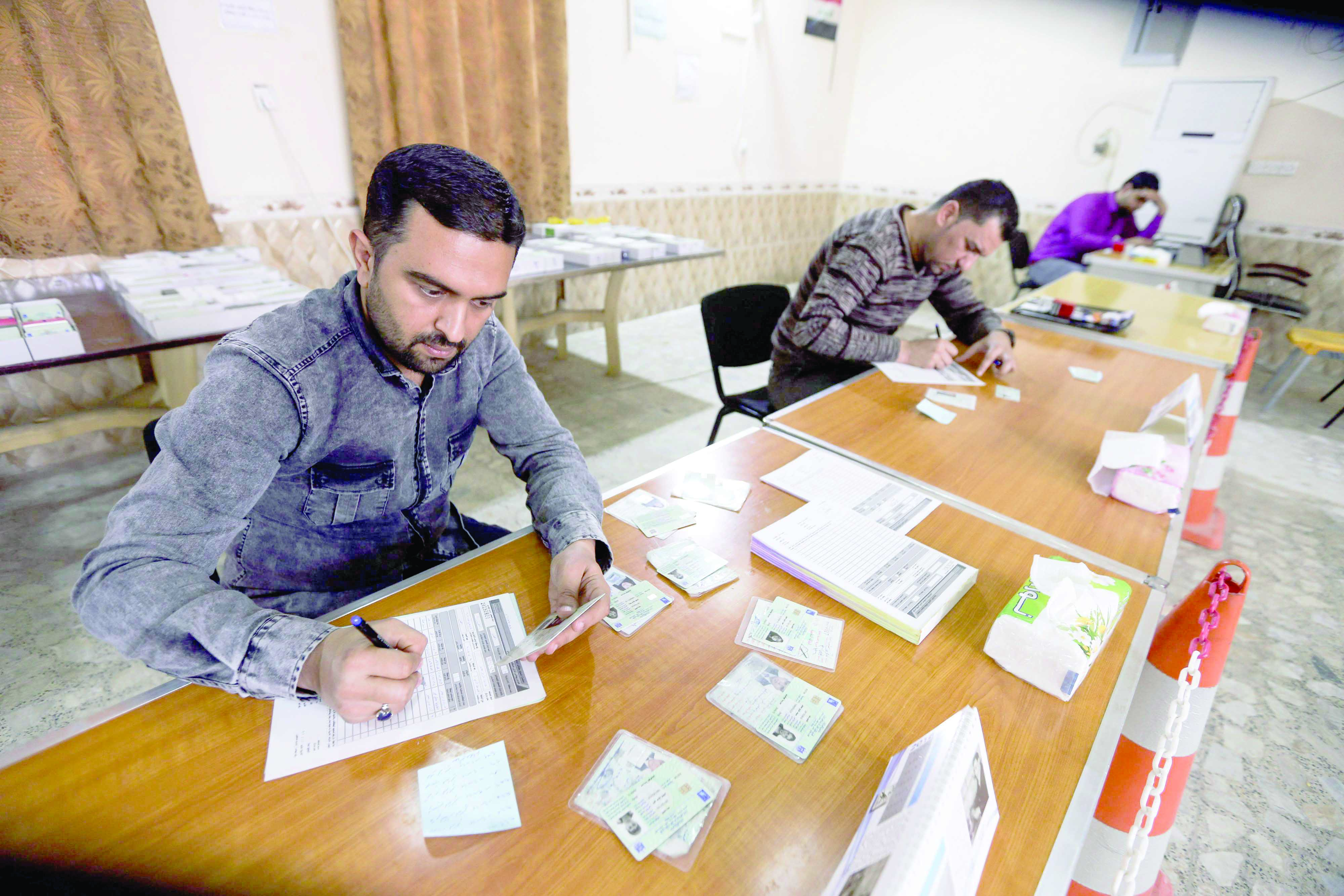 Iraqi electoral commission employees update voting registries for the May 2018 parliamentary elections. (AFP)