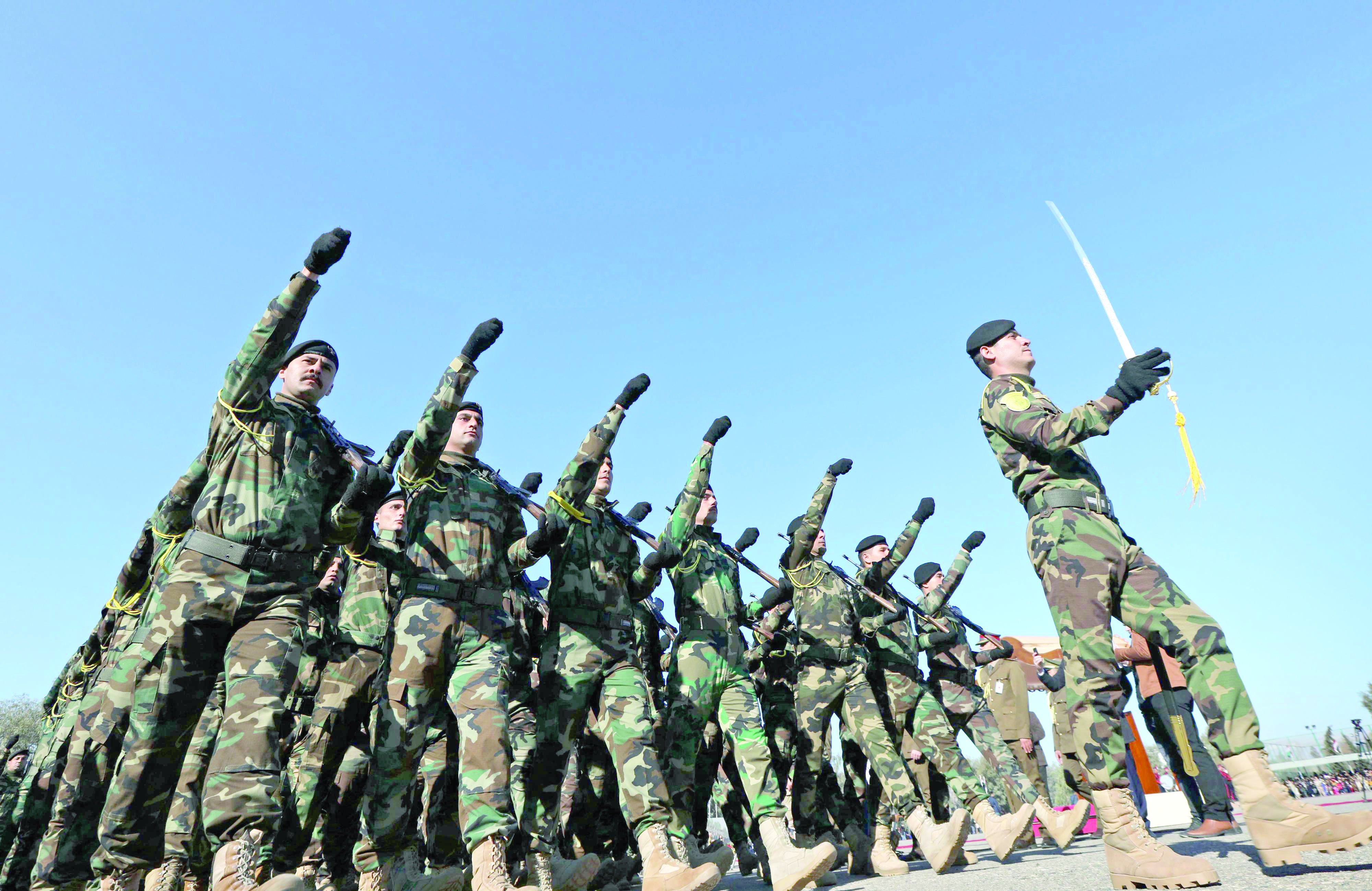 Iraqi Kurdish peshmerga fighters take part in a graduation ceremony at the Zakho military academy, last January. (AFP)