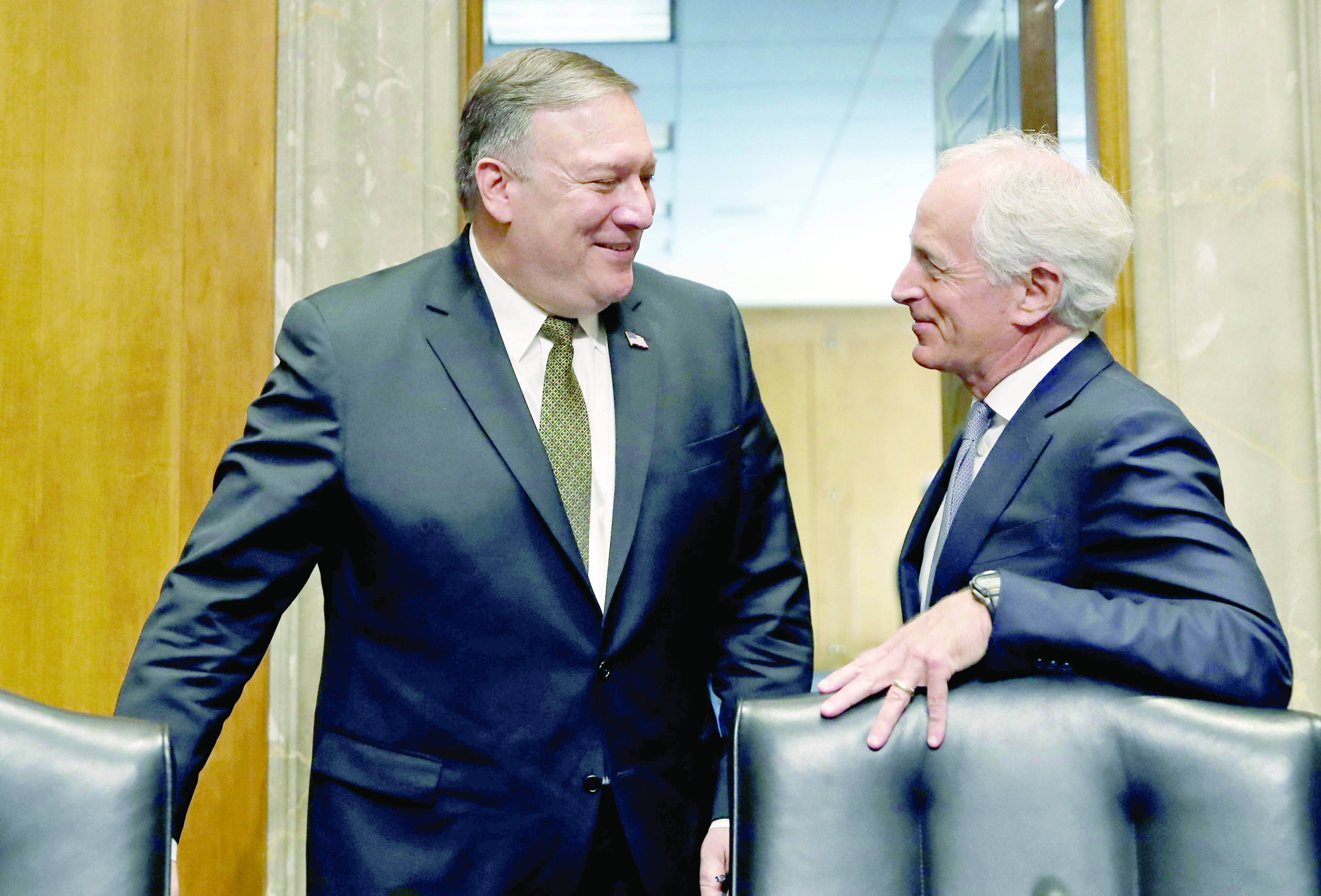 US Secretary of State-designate Mike  Pompeo (L) talks with Chairman Bob Corker after a break in the Senate Foreign Relations Committee, on April 12 (AP)