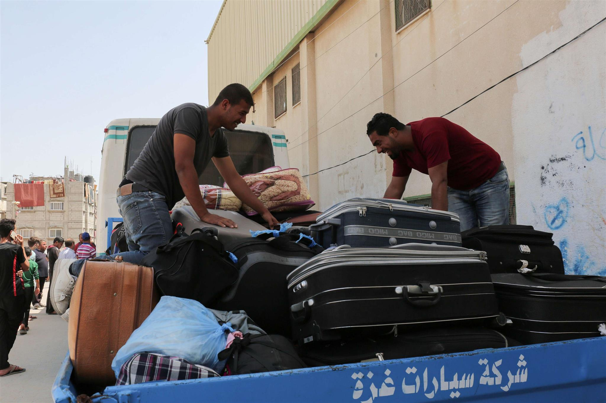 Palestinians wait to travel to Egypt through the Rafah border crossing in the southern Gaza Strip, on May 18.  (AFP)