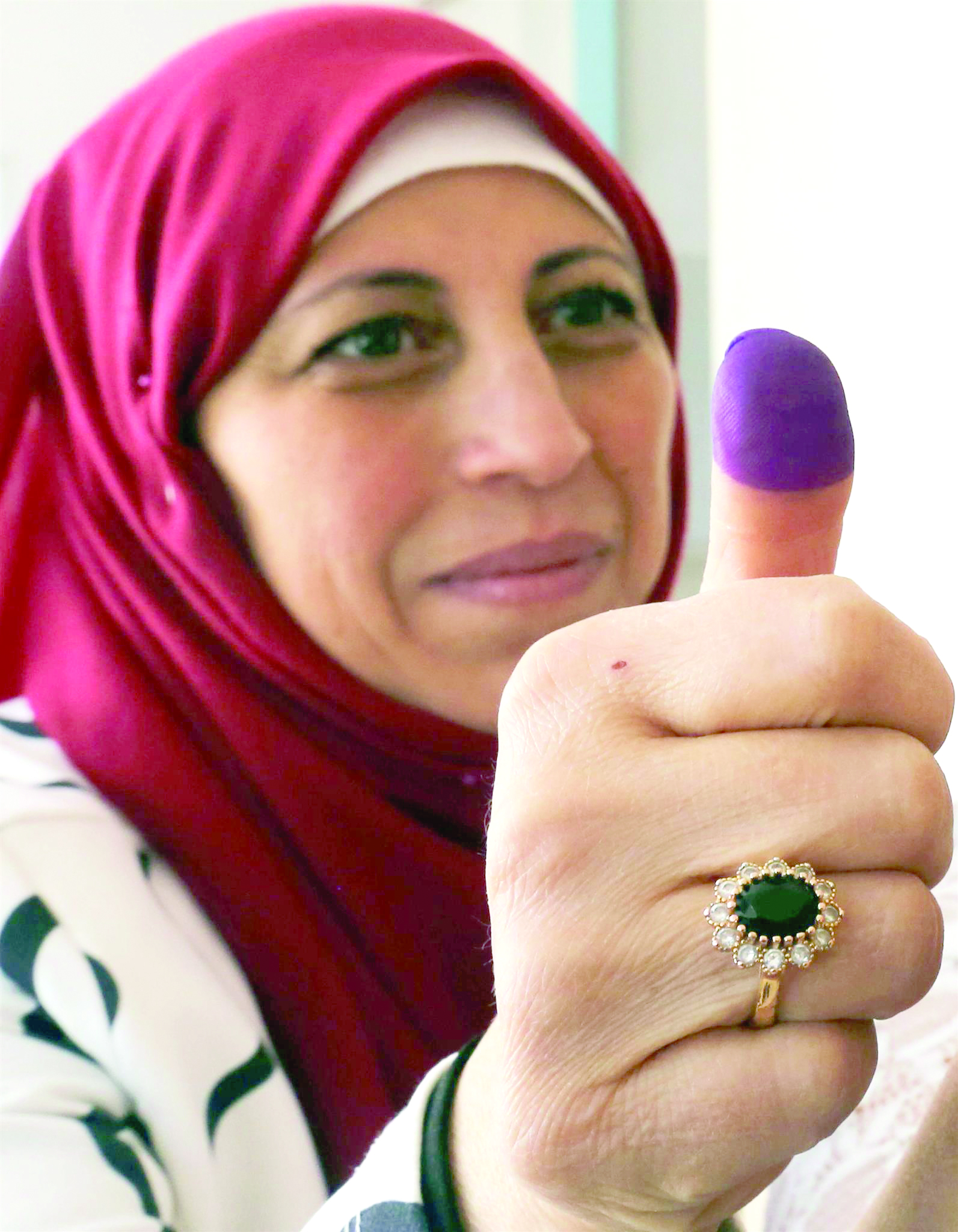 A state employee shows her ink-stained finger after casting her vote in Marjayoun in Lebanon, on May 3.(Reuters)