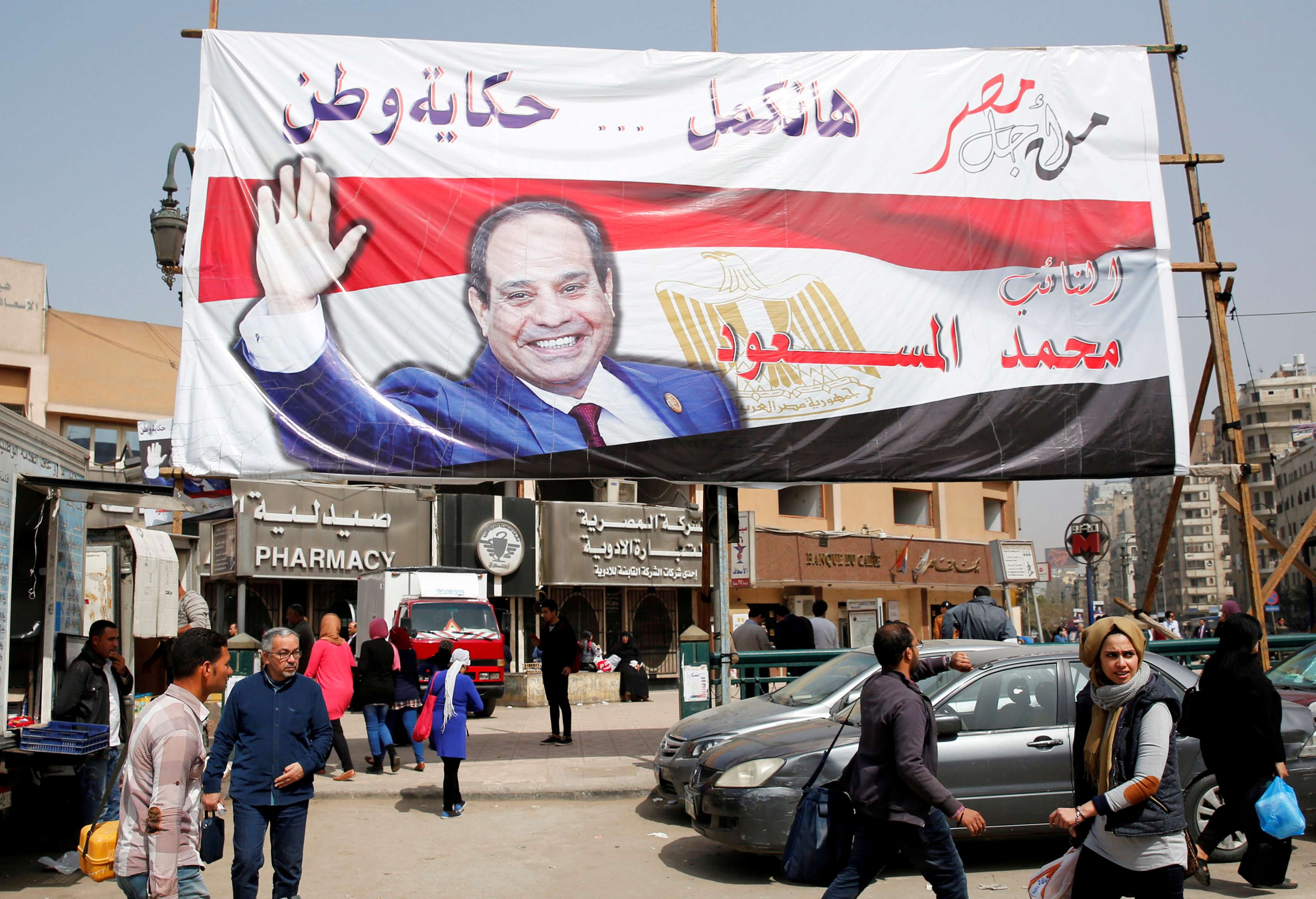 People walk by a poster of Egyptian President Abdel Fattah al-Sisi in Cairo.  (Reuters)