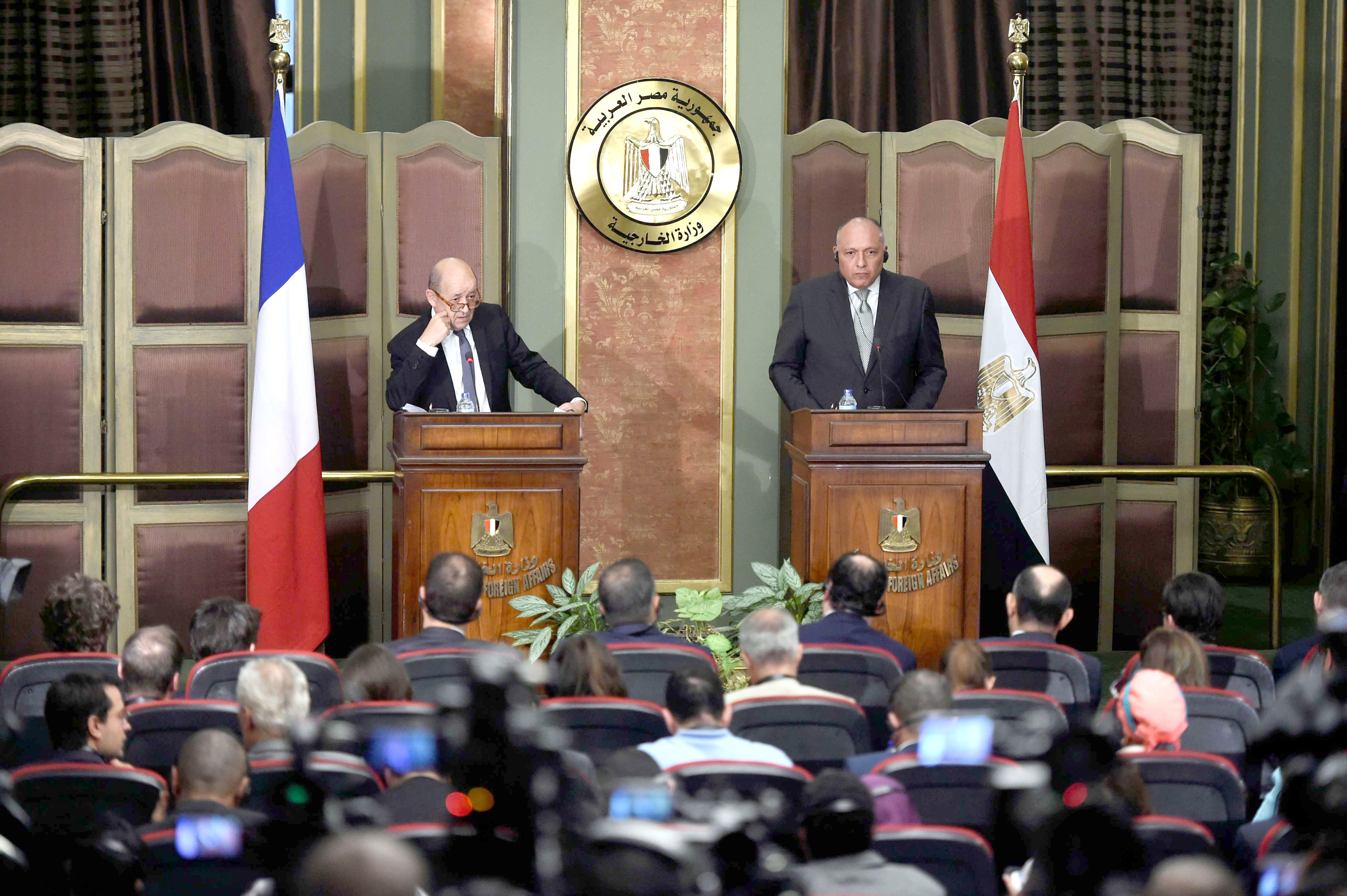 French Foreign Minister Jean-Yves Le Drian (L) speaks during a news conference with Egyptian Foreign Minister Sameh Shoukry in Cairo, on April 29. (AFP)