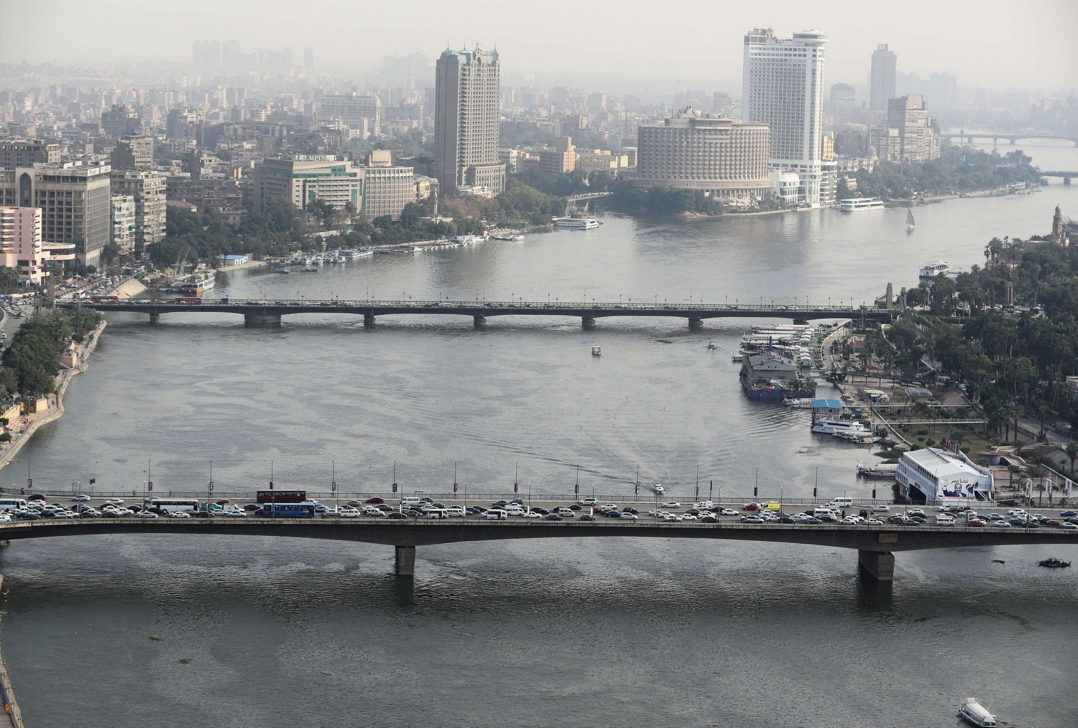 A general view of the 6th October Bridge (bottom) and Kasr El Nil Bridge (top), which span the Nile River in Cairo. (Reuters)