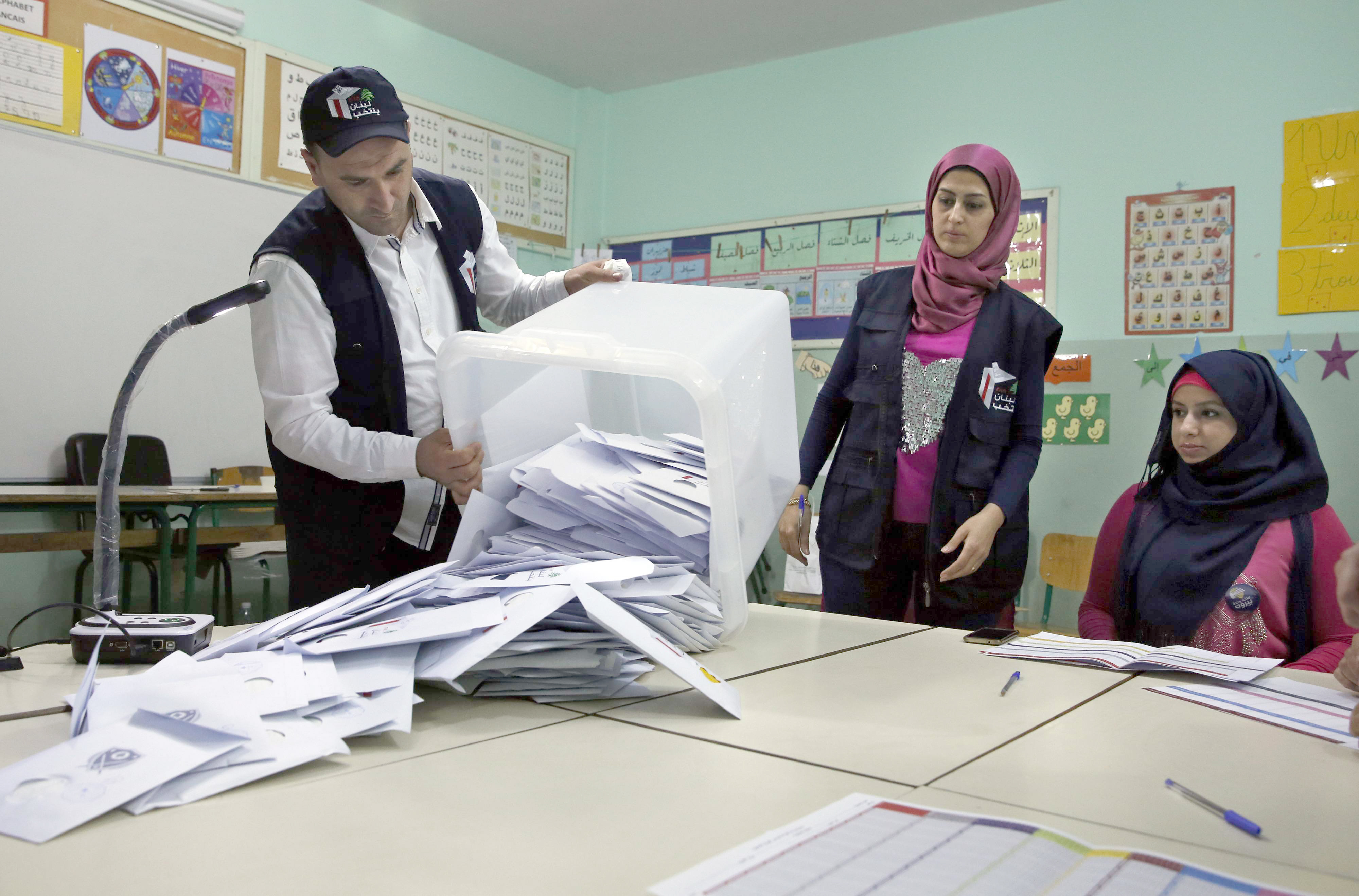 Election officials prepare to count ballots shortly after the polling stations closed in Beirut, on May 6.(AP)