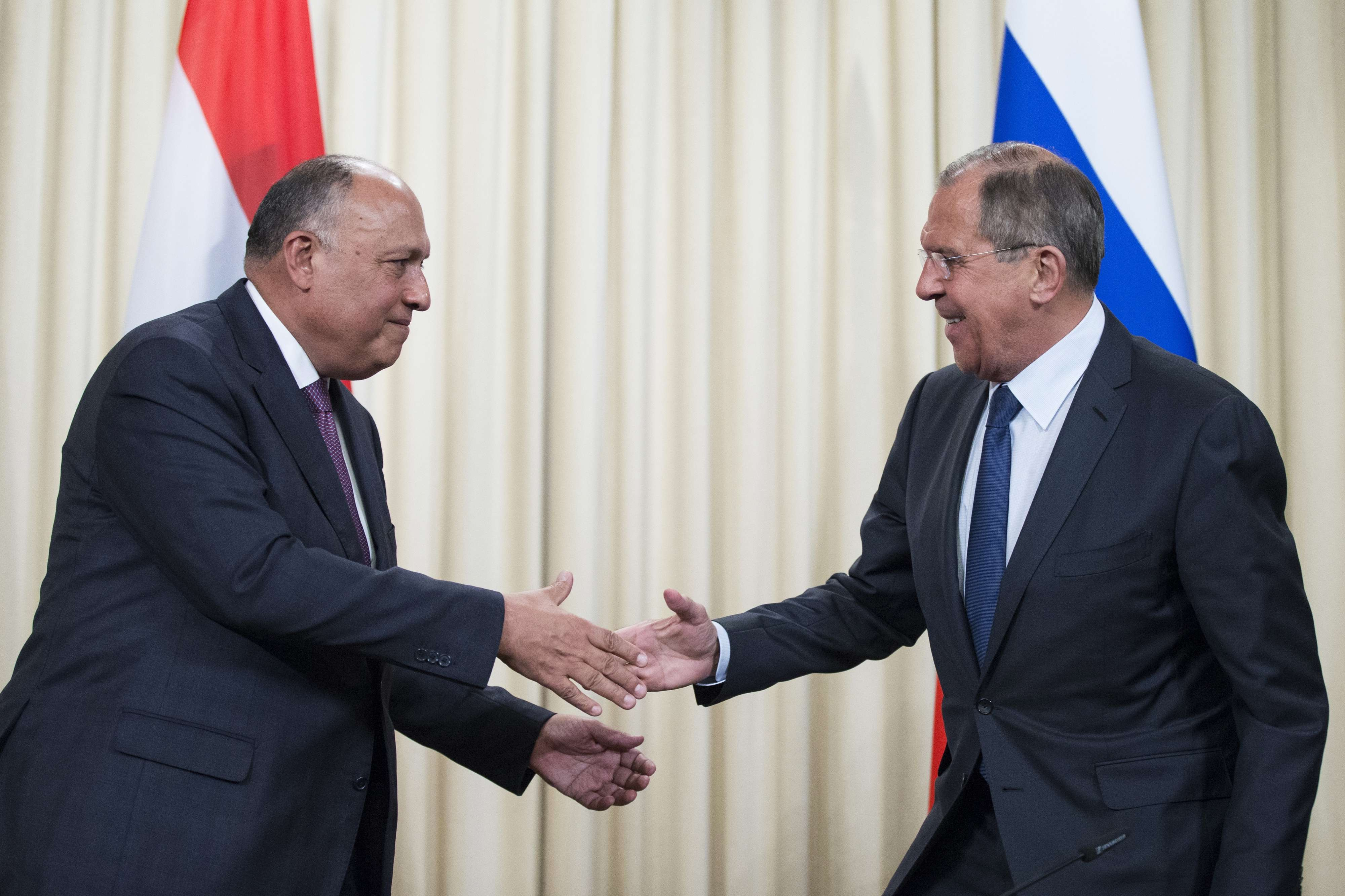 Close cooperation. Russian Foreign Minister Sergei Lavrov (R) shakes hands with Egyptian Foreign Minister Sameh Shoukry  after a joint news conference in Moscow, on May 14. (AP)