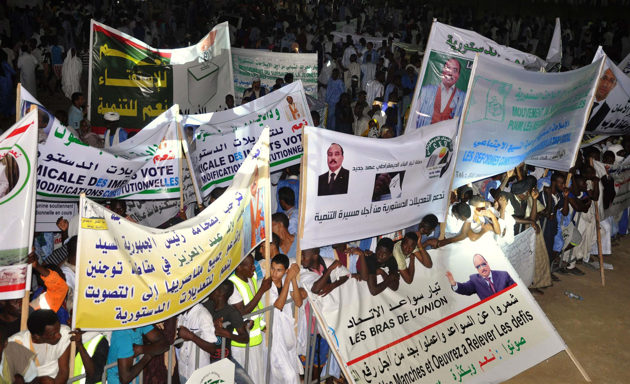 Politics of recruitment. A July 2017 file picture shows supporters of Mauritanian President gathering and holding banners during a rally in Nouakchott.  (AFP)