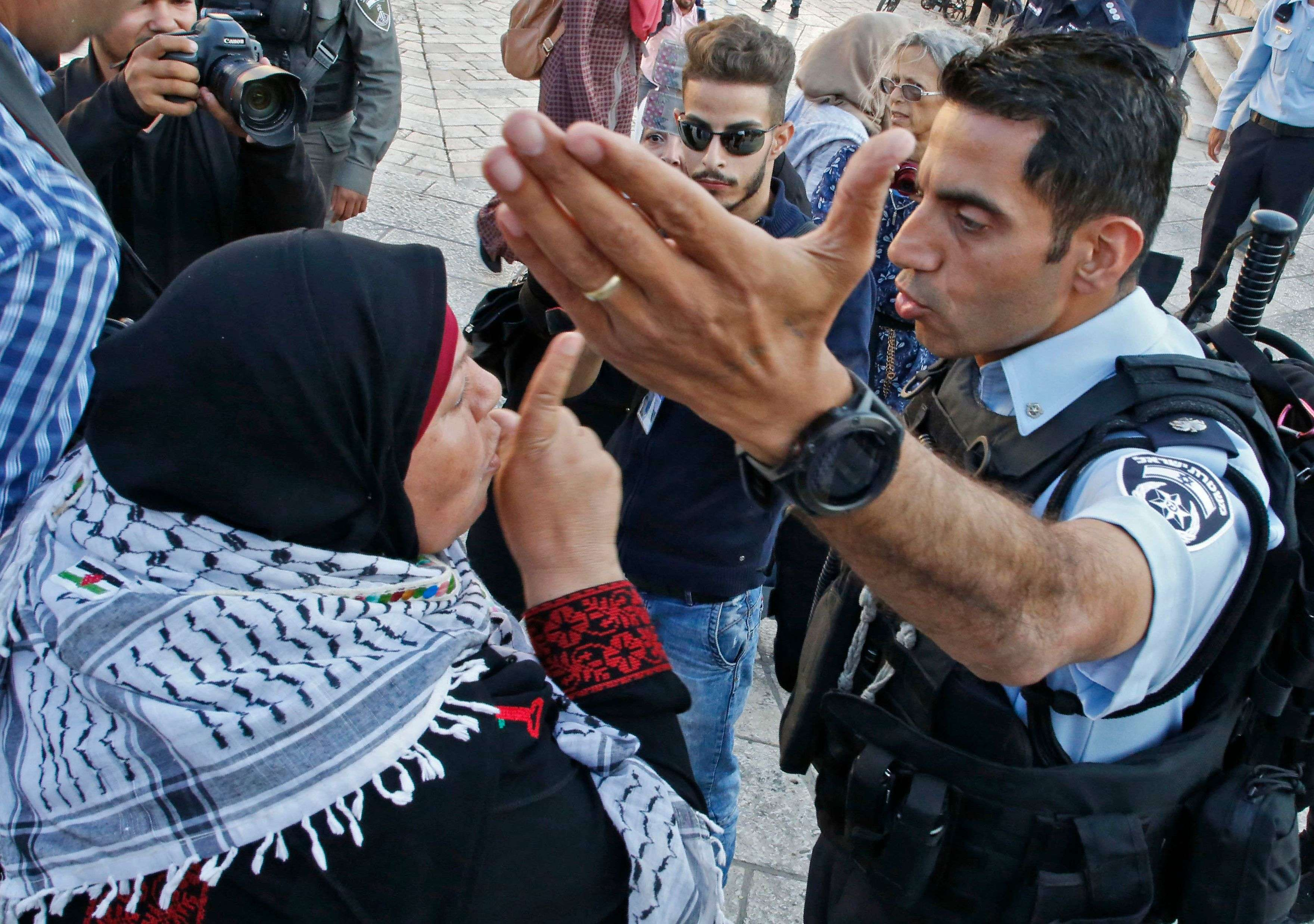 A Palestinian woman argues with a member of the Israeli security forces outside the Damascus Gate in the Old City of Jerusalem, on May 15. (AFP)