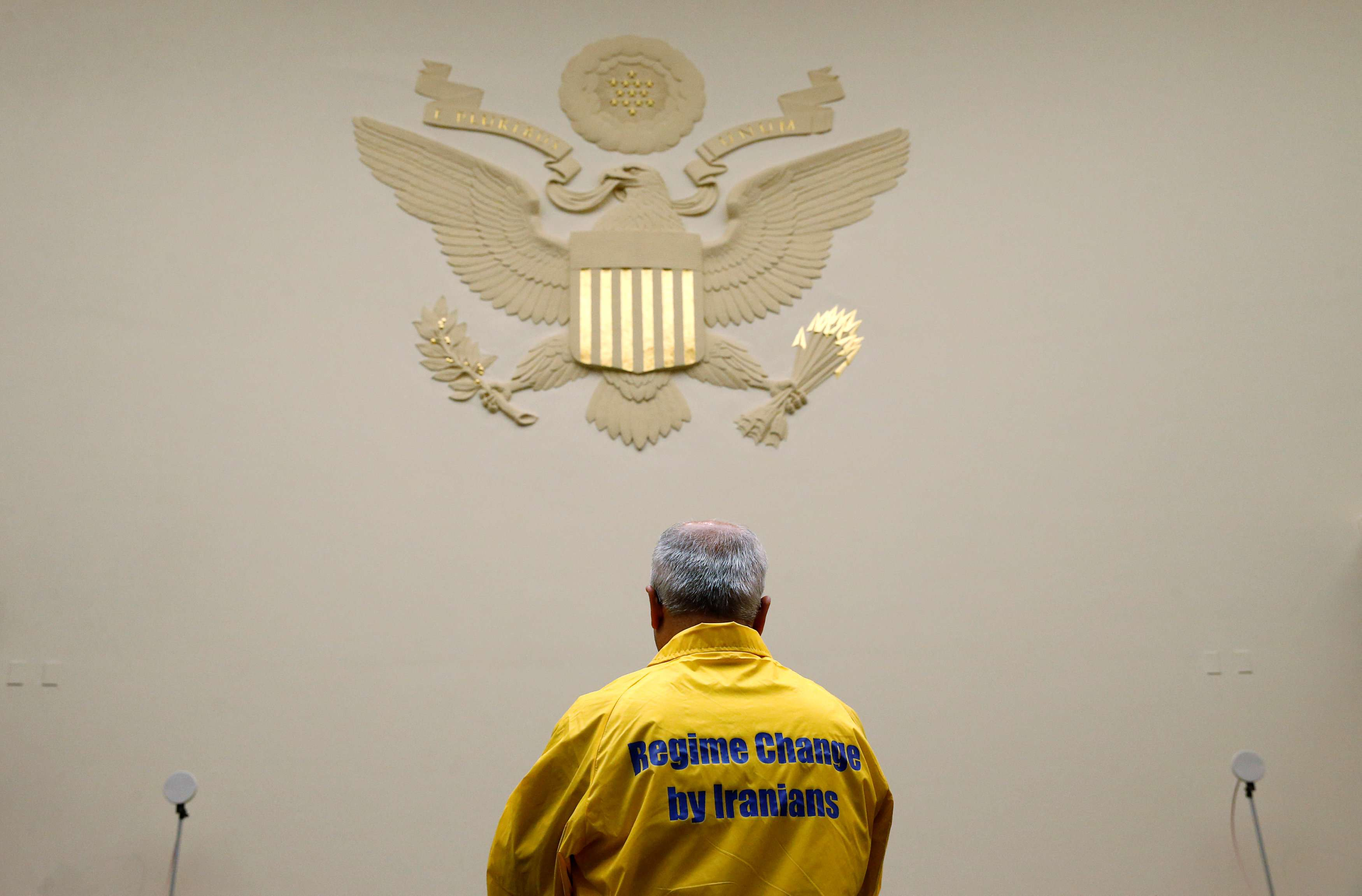 A demonstrator awaits the arrival of US Secretary of State Mike Pompeo at a hearing of the US House Foreign Affairs Committee on Capitol Hill in Washington,  on May 23. (Reuters)