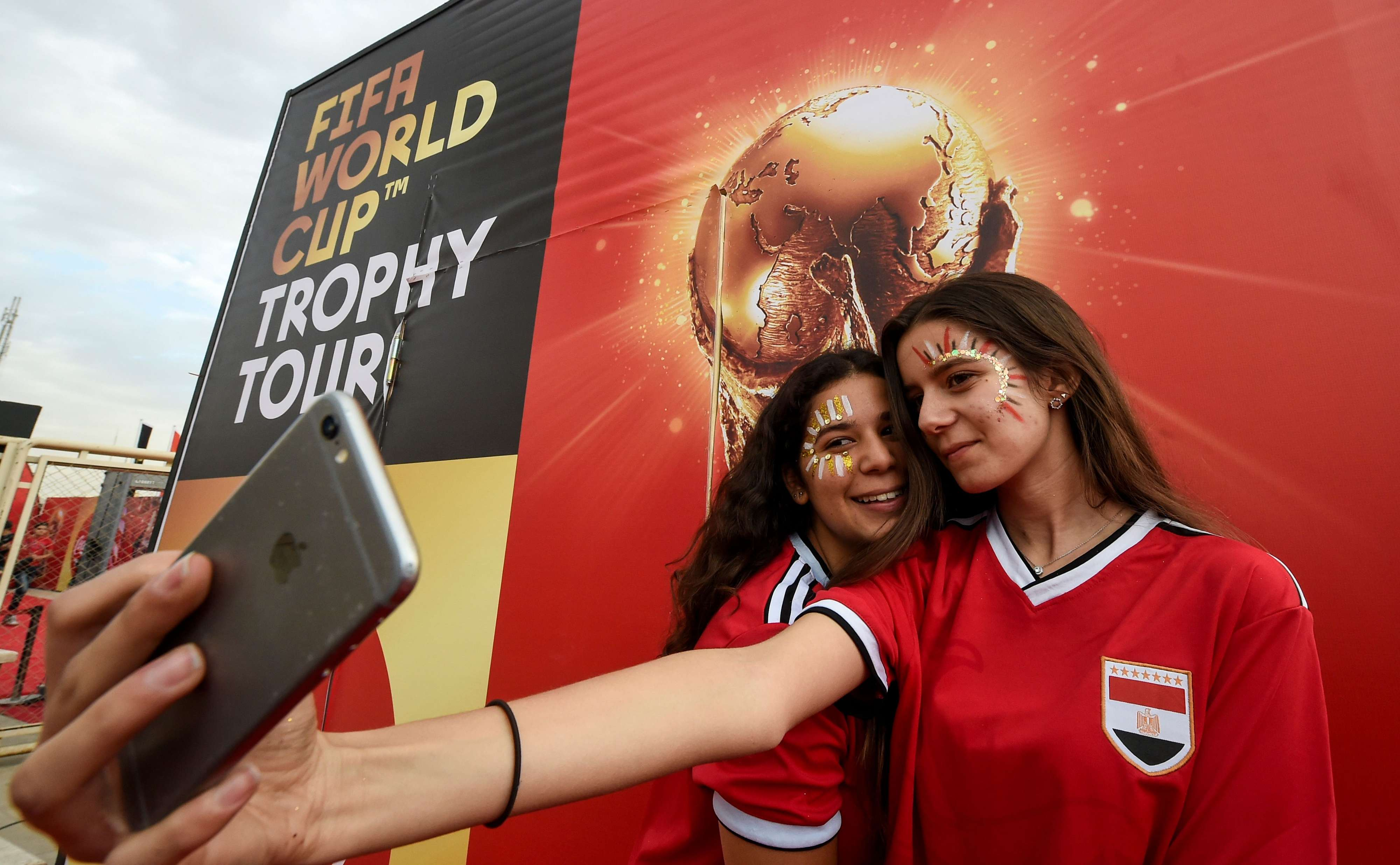 Female Egyptian football fans pose for a selfie during a FIFA World Cup Trophy tour event in Cairo, last March. (AFP)