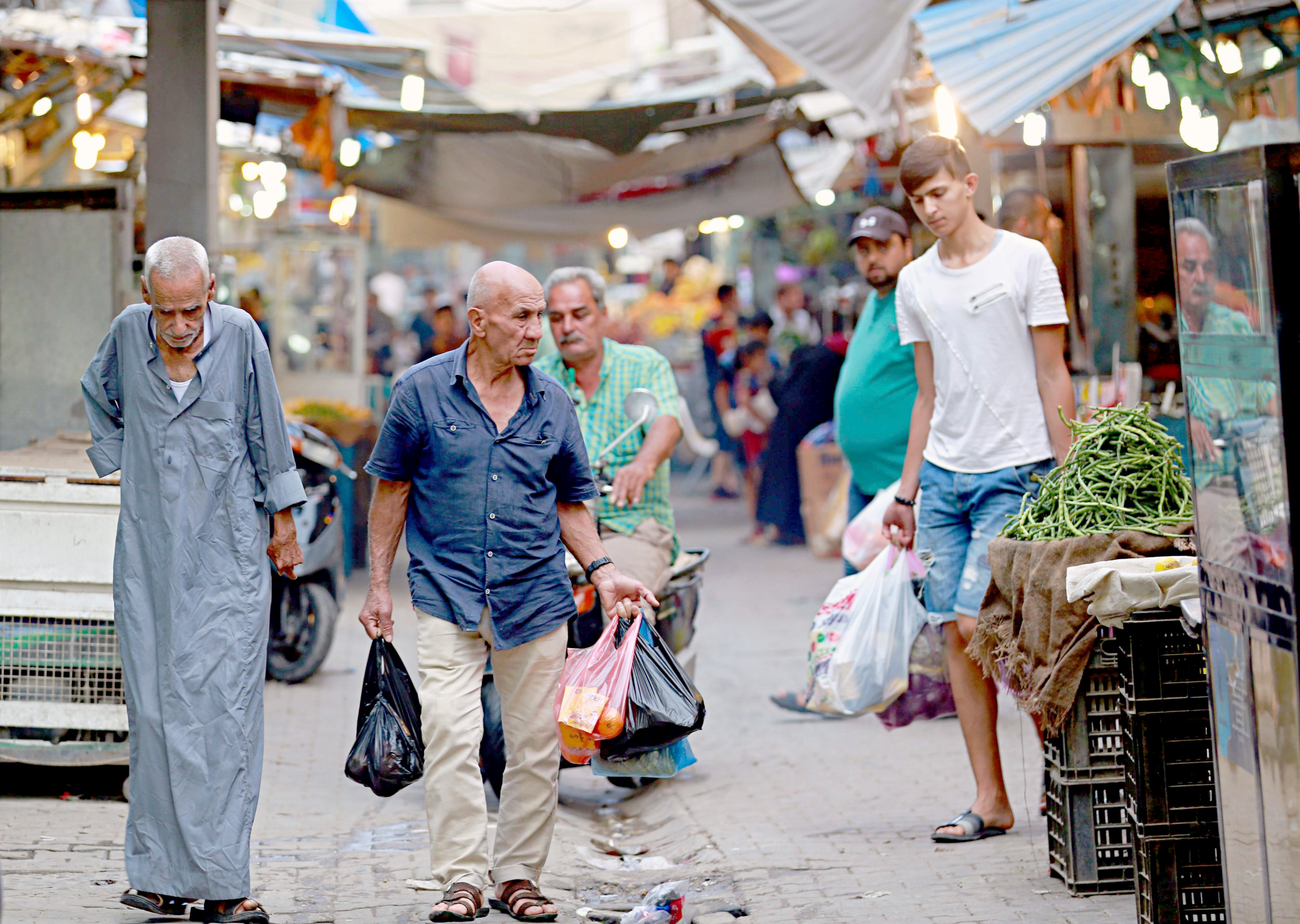 People shop in the main market of  the predominately Sunni neighbourhood of Azamiya in north Baghdad. (AP)
