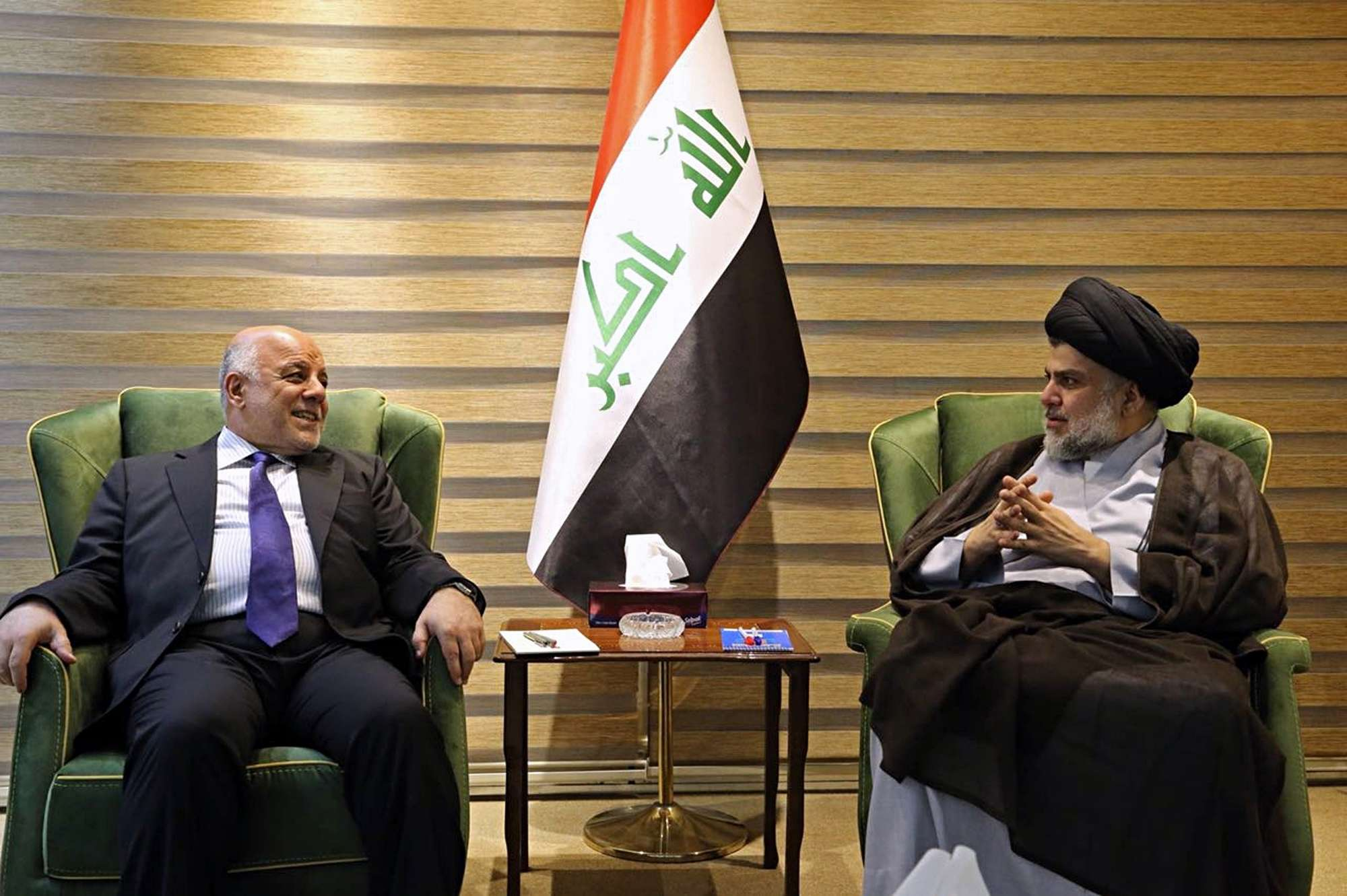 Iraqi Prime Minister Haider al-Abadi (L) meets with Shia cleric Muqtada al-Sadr in the heavily fortified Green Zone in Baghdad, on May 20. (Iraqi Government)