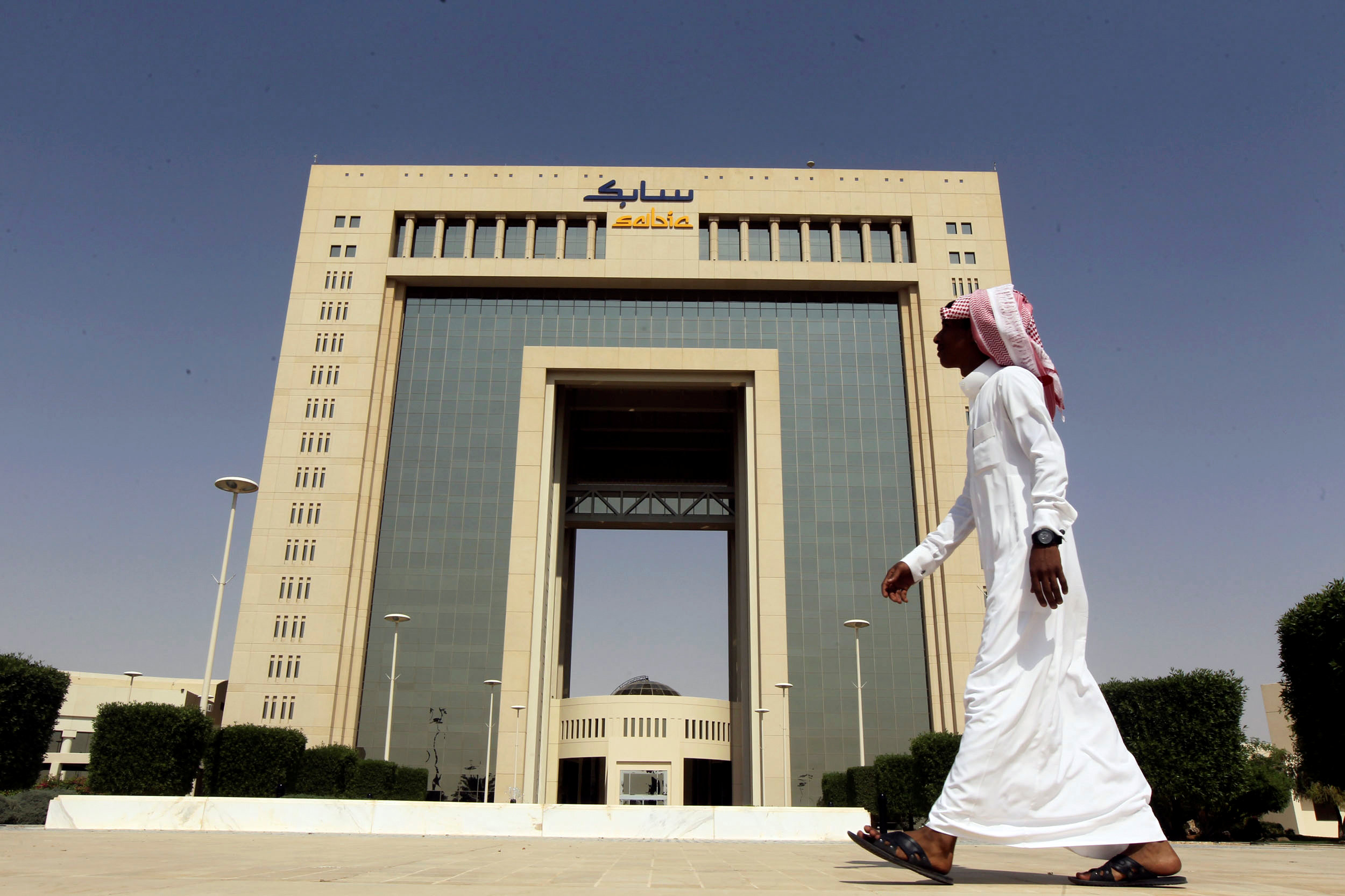 A man walks past the headquarters of Saudi Basic Industries Corp (SABIC) in Riyadh. (Reuters)
