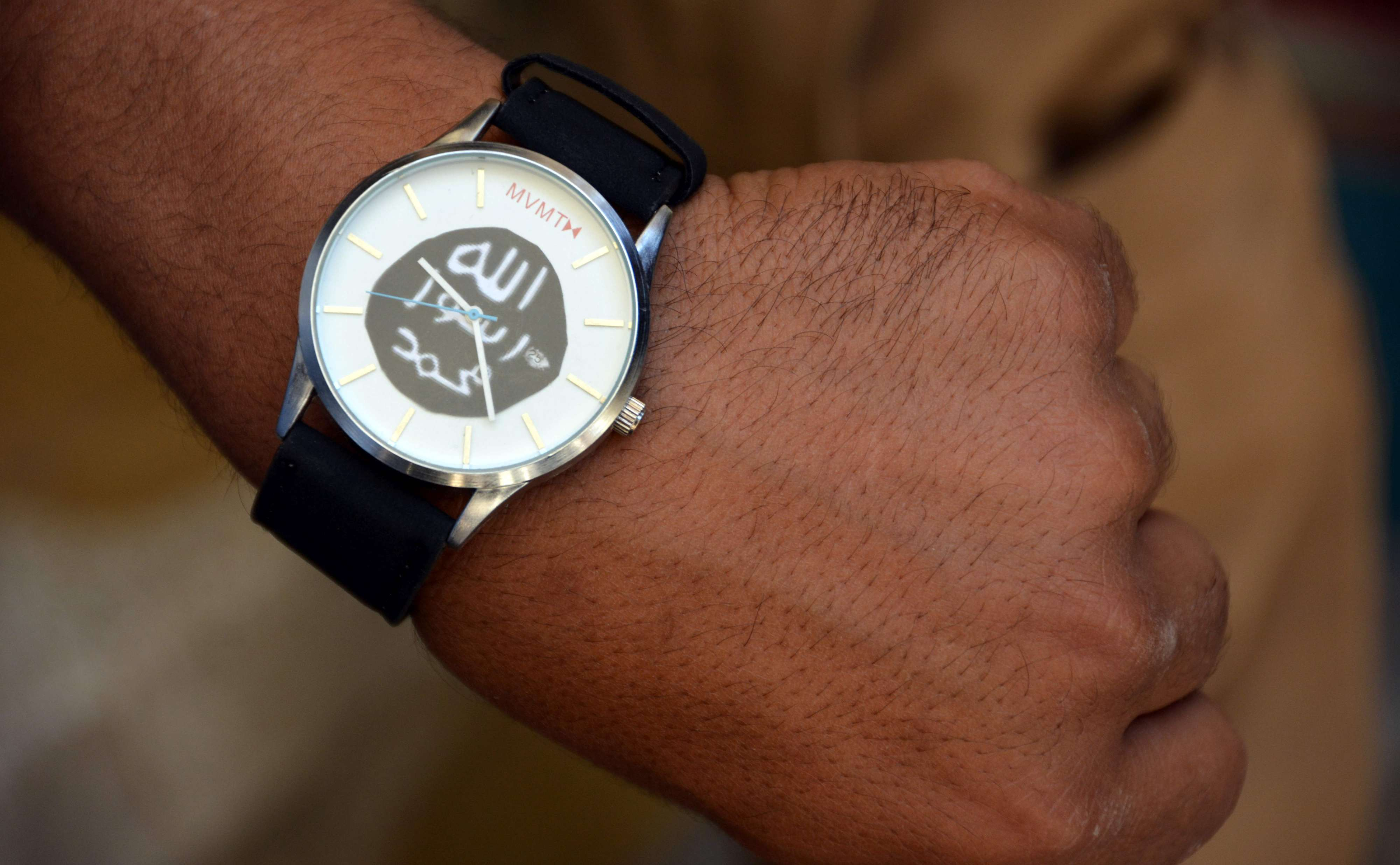 A watch that belonged to a former Islamic State (ISIS) fighter, bearing the group's logo. (AFP)