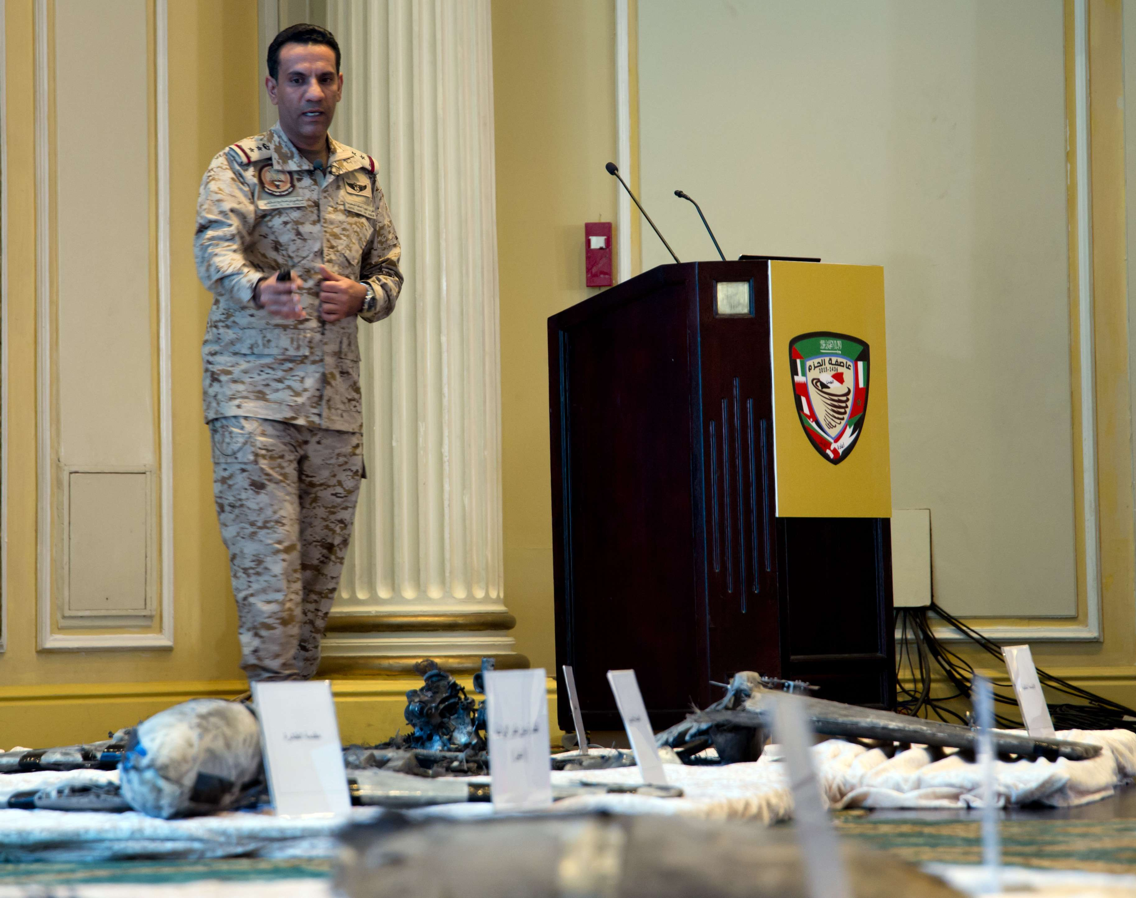 Colonel Turki al-Malki, spokesman  for the Saudi-led coalition in Yemen, displays wreckage from Iranian-Houthi suicide drones in Khobar city, last April. (AP)