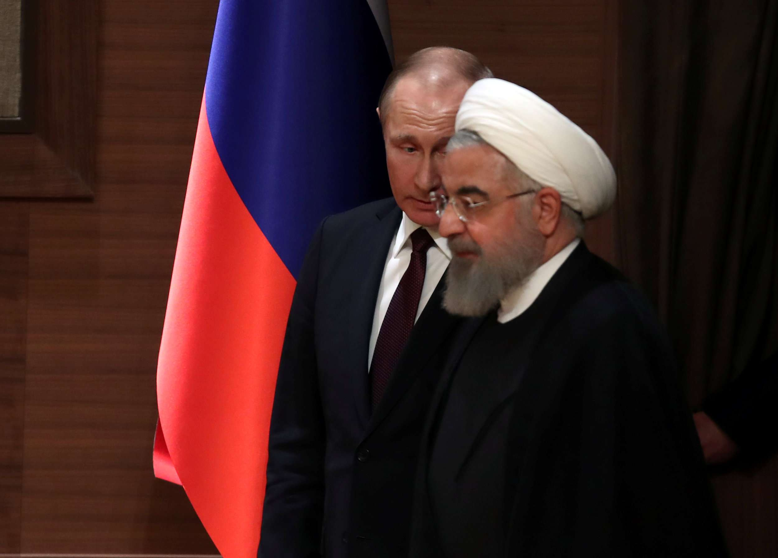 Russian President Vladimir Putin (L) and his Iranian counterpart Hassan Rohani  arrive for a joint news conference in Ankara, last April. (Reuters)