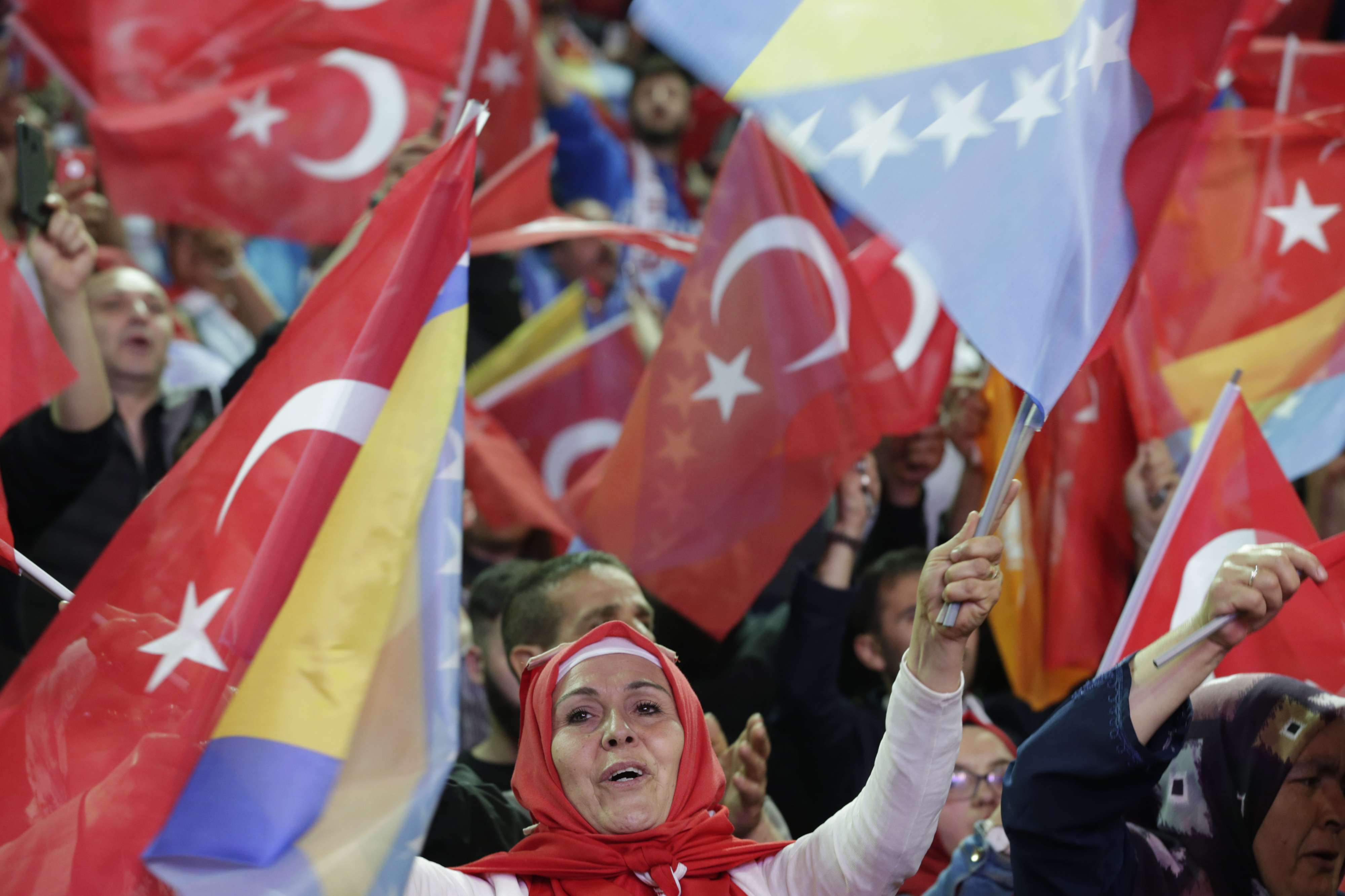 Zealous followers. Supporters of Turkish President Recep Tayyip Erdogan wave Turkish flags during a rally in Sarajevo, on May 20. (AP)
