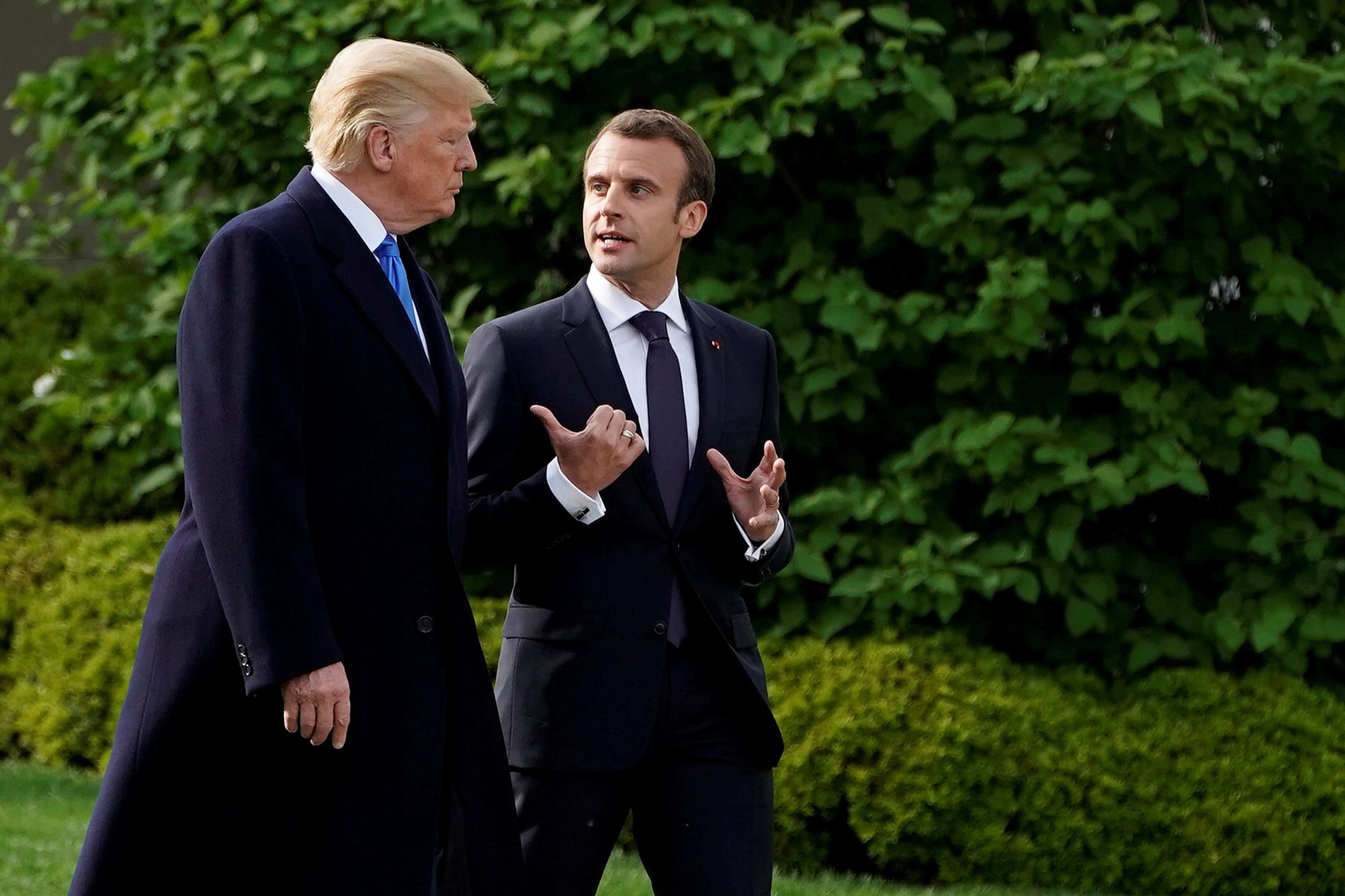 US President Donald Trump (L) and French President Emmanuel Macron walk from the Oval Office in Washington, on April 23. (Reuters)