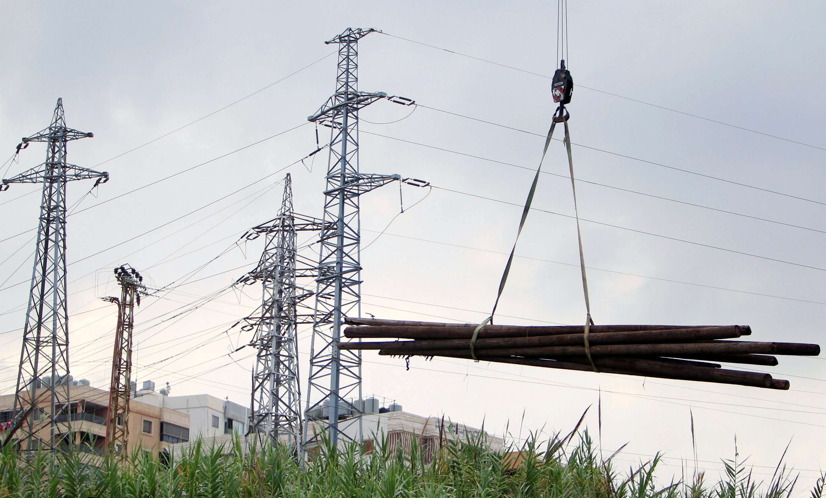 Electricity pylons are seen in Sidon in southern Lebanon. (Reuters)