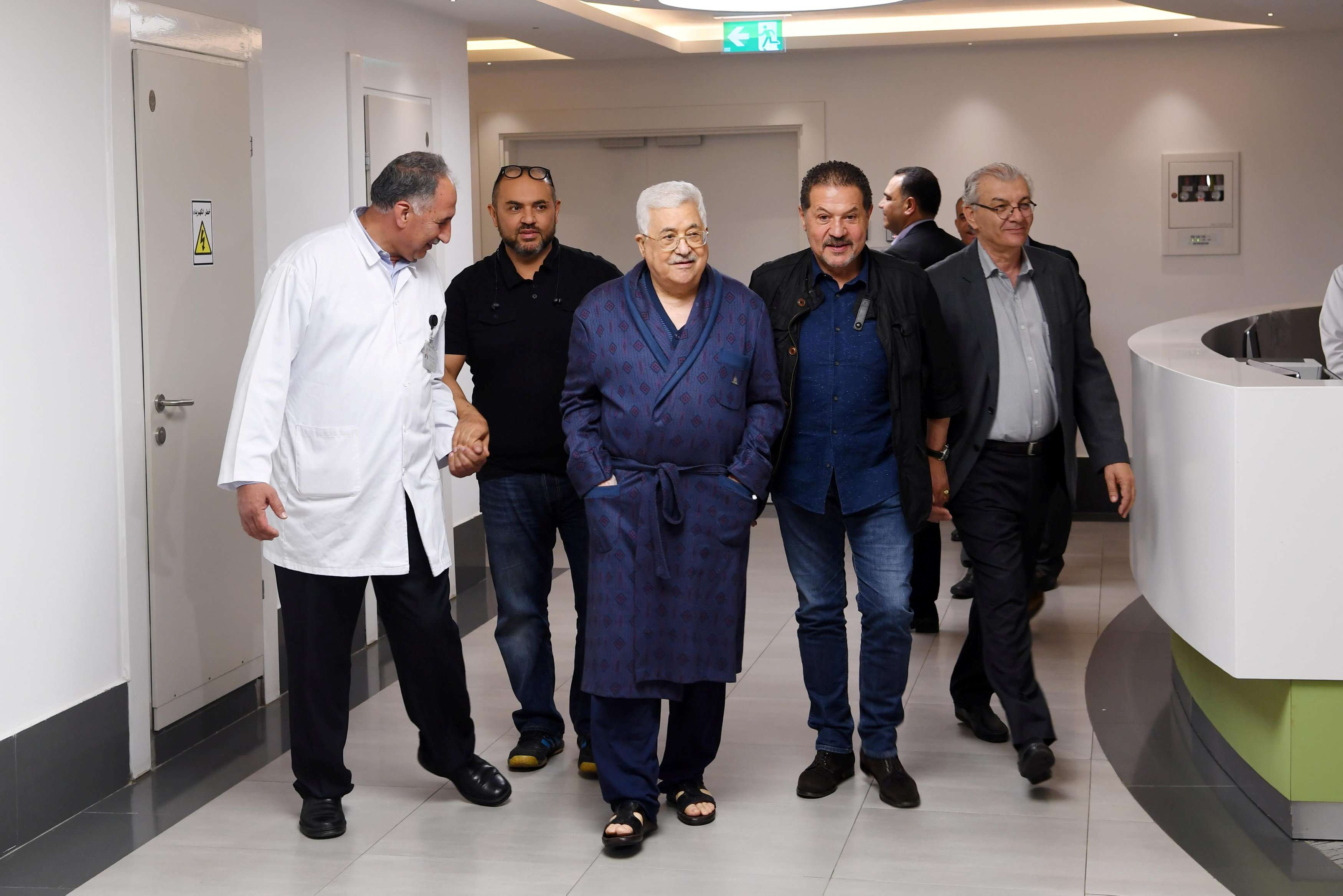 Palestinian President Mahmoud Abbas walks inside a hospital in Ramallah in the occupied West Bank, on May 21. (Palestinian President Office)