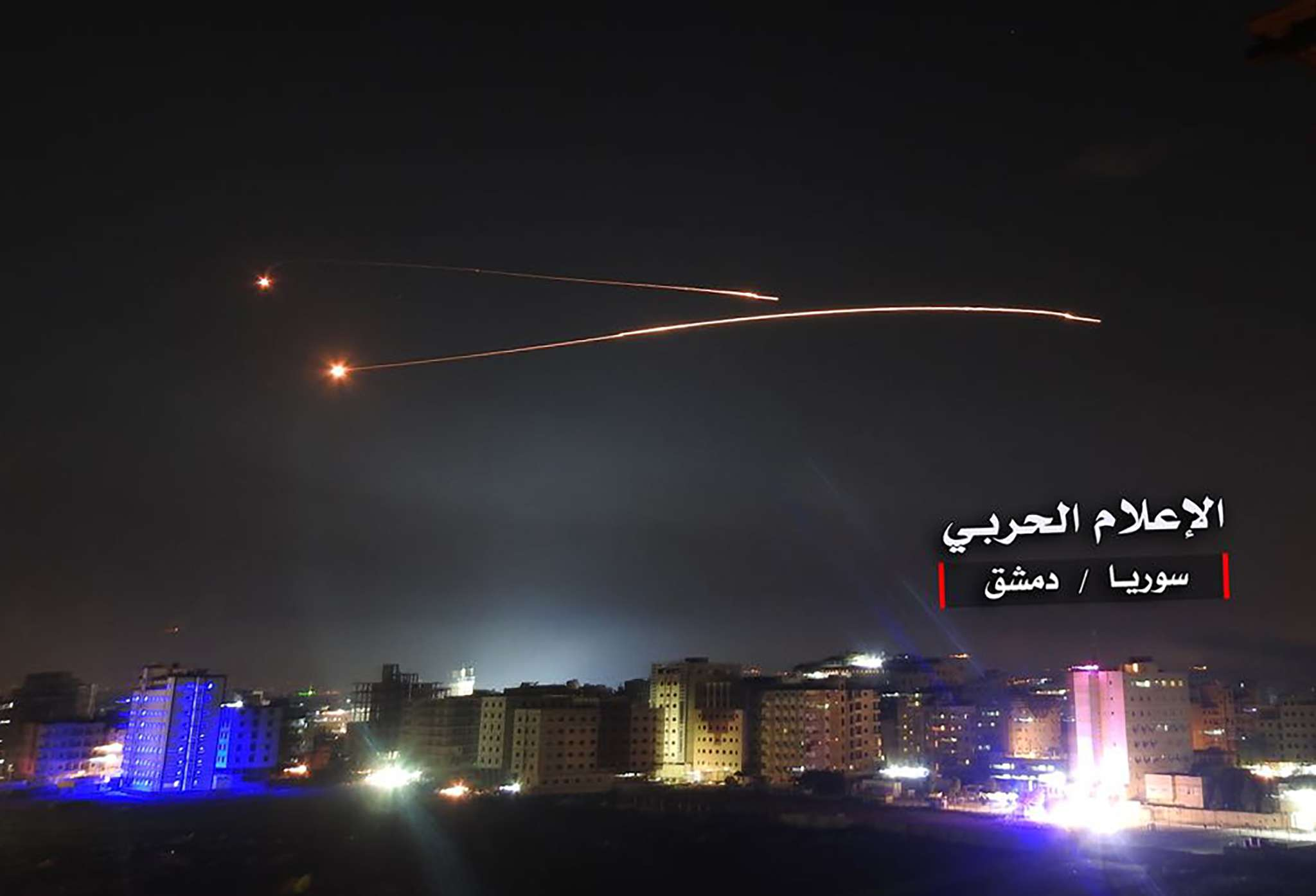 An image released by the government-affiliated 'Central War Media' in Syria purportedly shows Syrian air defence systems intercepting Israeli missiles over Damascus' airspace, on May 10. (AFP / CENTRAL WAR MEDIA).