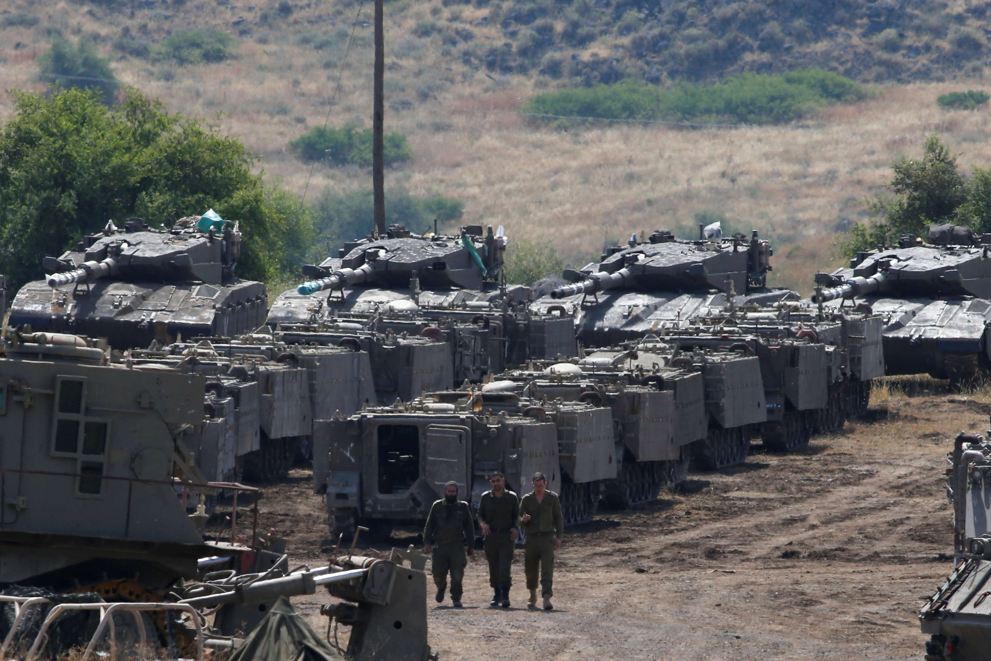 Israeli soldiers walk among armored vehicles in the Israeli-occupied Golan Heights, on May 10. (Reuters)