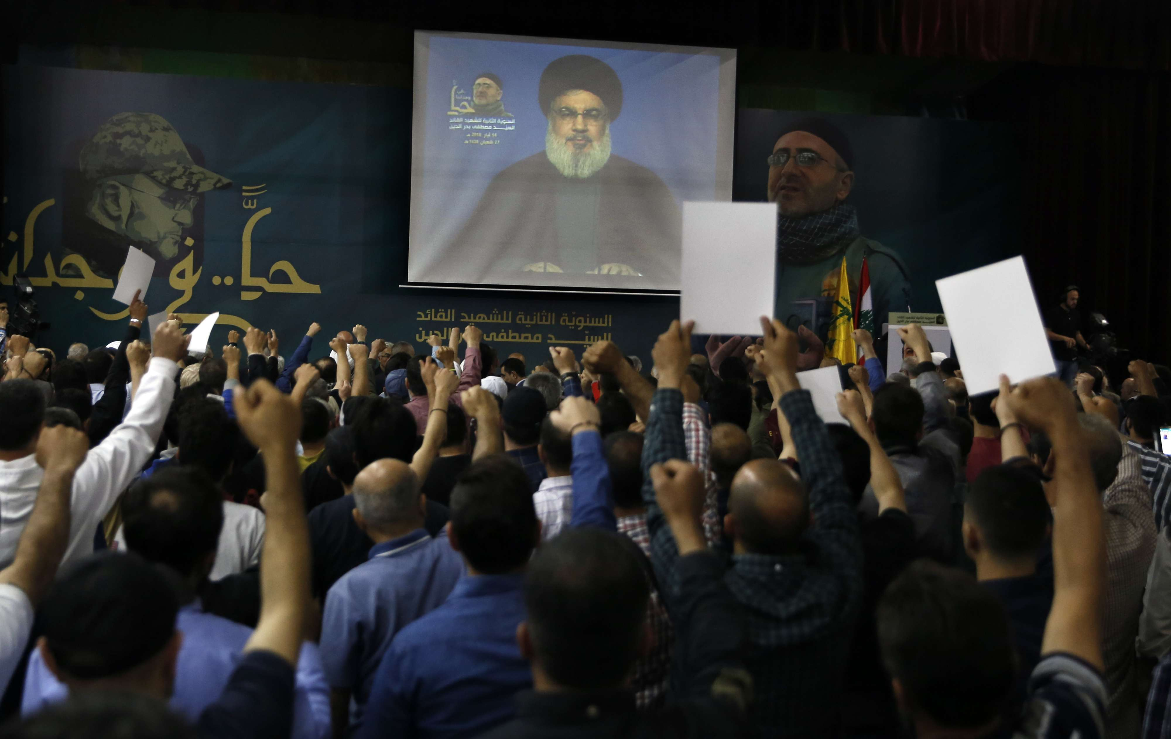 Lebanon's Hezbollah leader Hassan Nasrallah speaks on a screen via a video link in the southern suburbs of Beirut, on May 14. (AP)