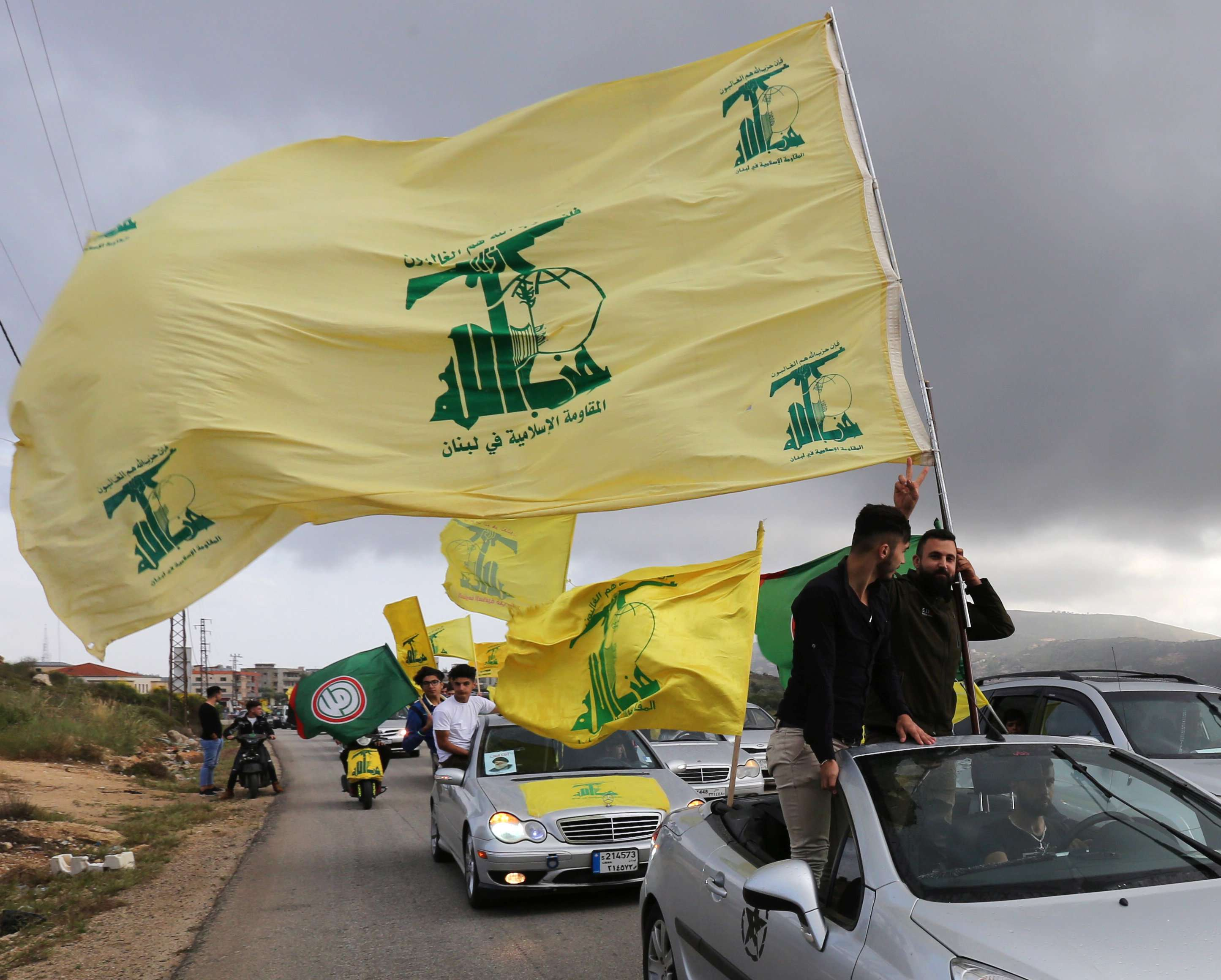 Supporters of Lebanon's Hezbollah gesture as they ride cars and hold Hezbollah flags in Marjayoun, Lebanon May 7. (Reuters)
