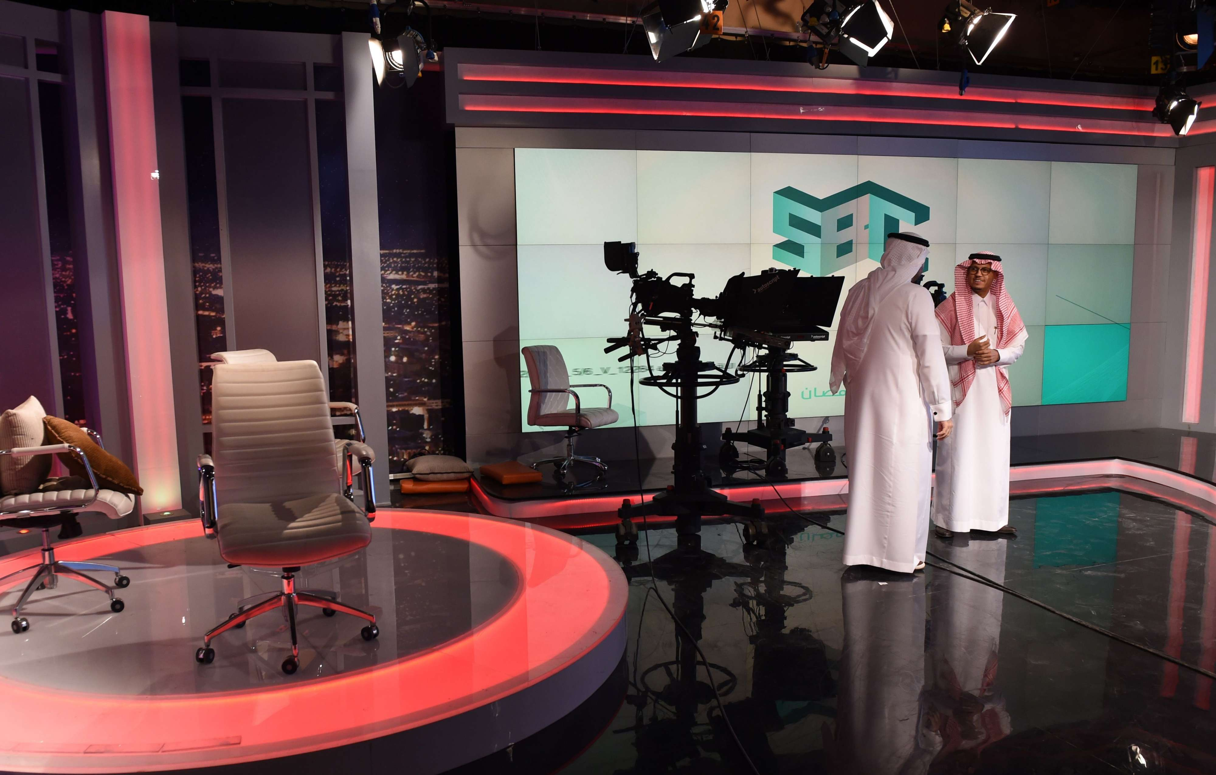 "Fahad Shlayel, Director General of the Production and Programms (R) talks to an employee at the studio of the new channel Saudi Broadcasting Corporation ""SBC"" in Riyadh, on April 24. (AFP)"