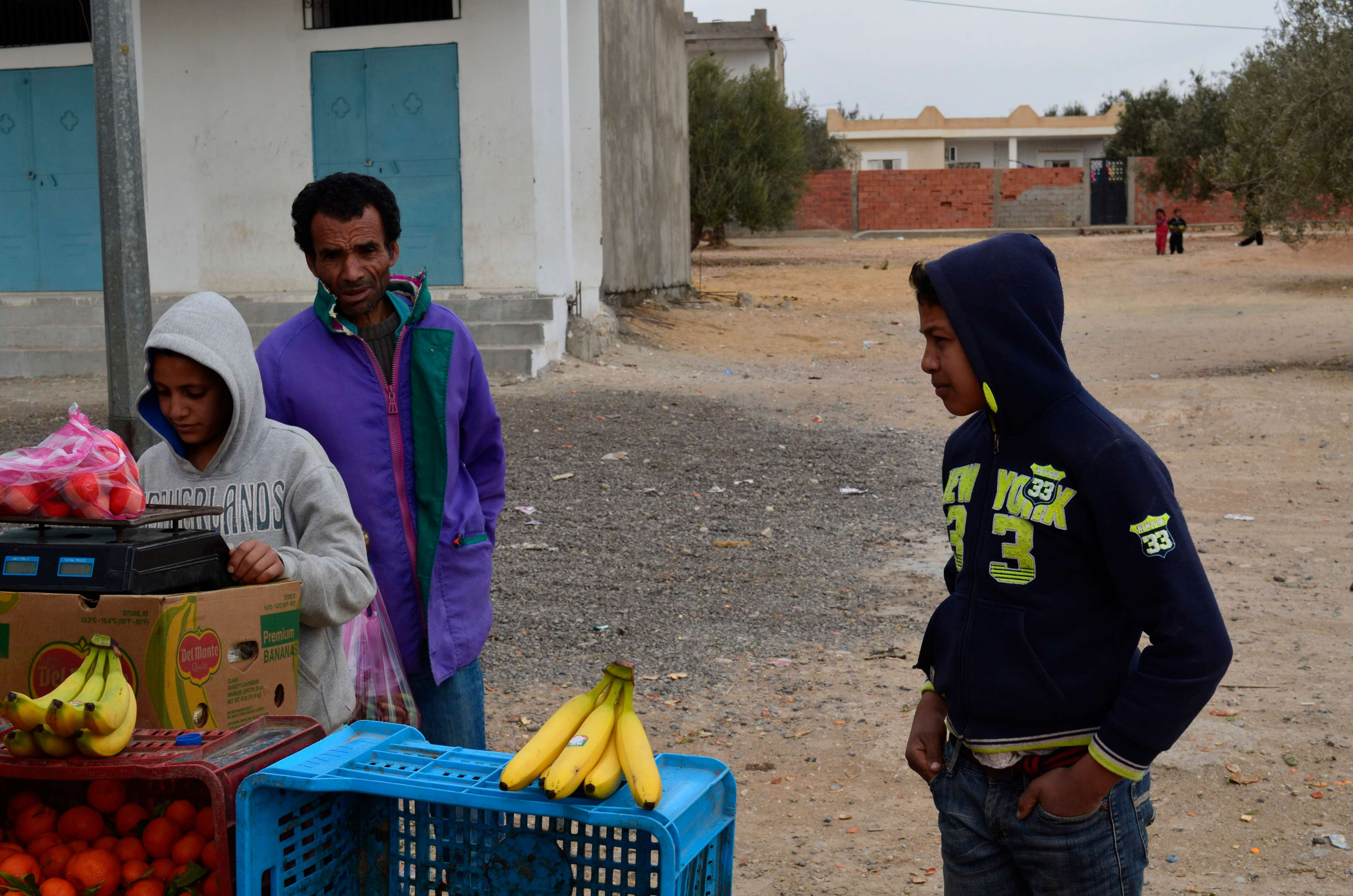 Young Tunisian vendors selling fruit on the side of a highway south of Tunis, last February. (Cain Burdeau via AP)
