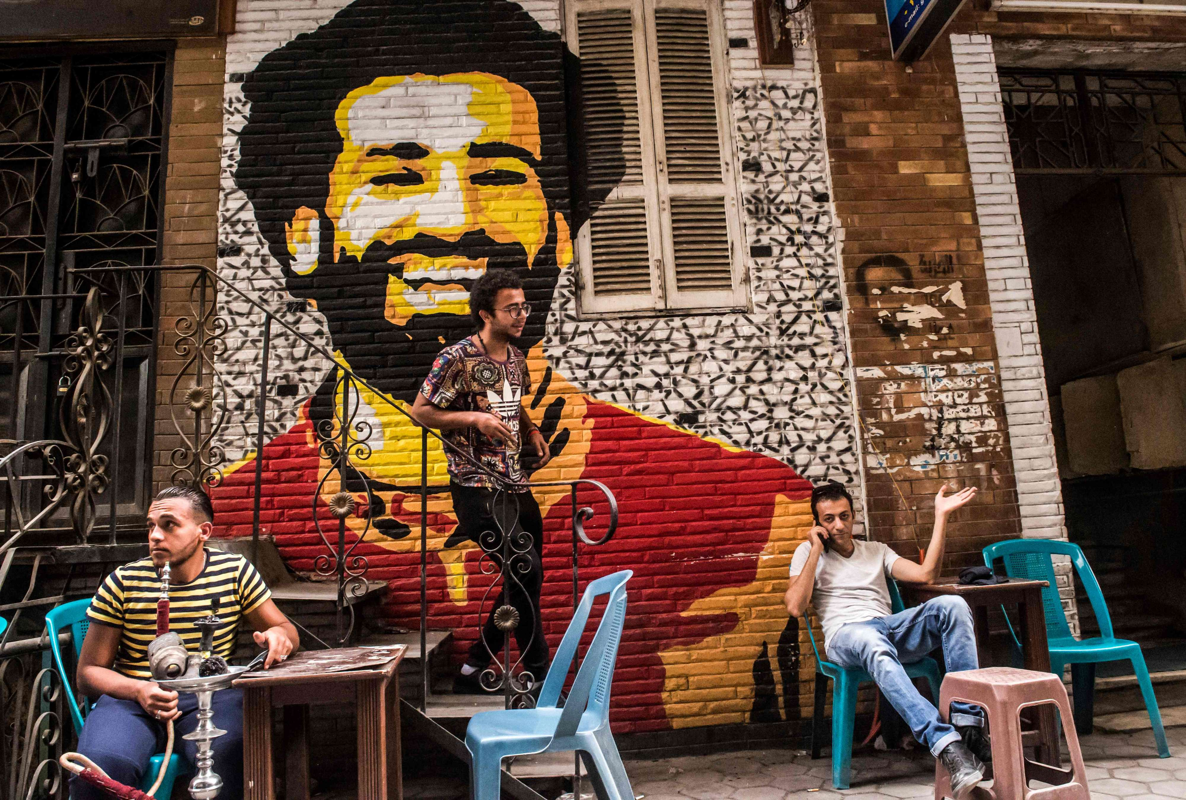 High hopes. A Cairo open-air cafe displays a mural by Egyptian artist Ahmed Fathy (C) showing Liverpool's Egyptian midfielder Mohamed Salah.     (AFP)