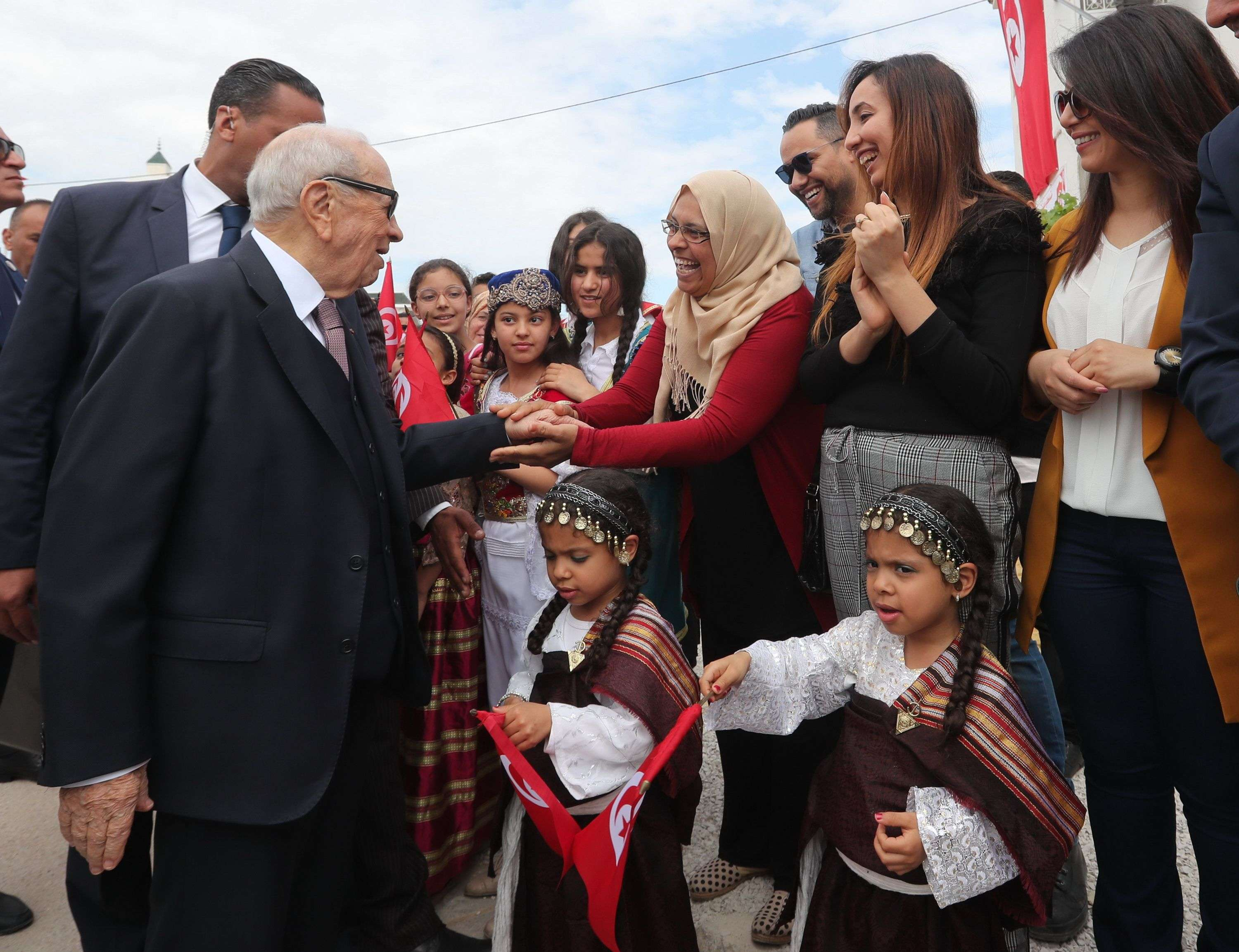 Tunisian President Beji Caid Essebsi greets people upon his arrival to cast his vote at a polling station in Soukra, on May 6. (AFP)