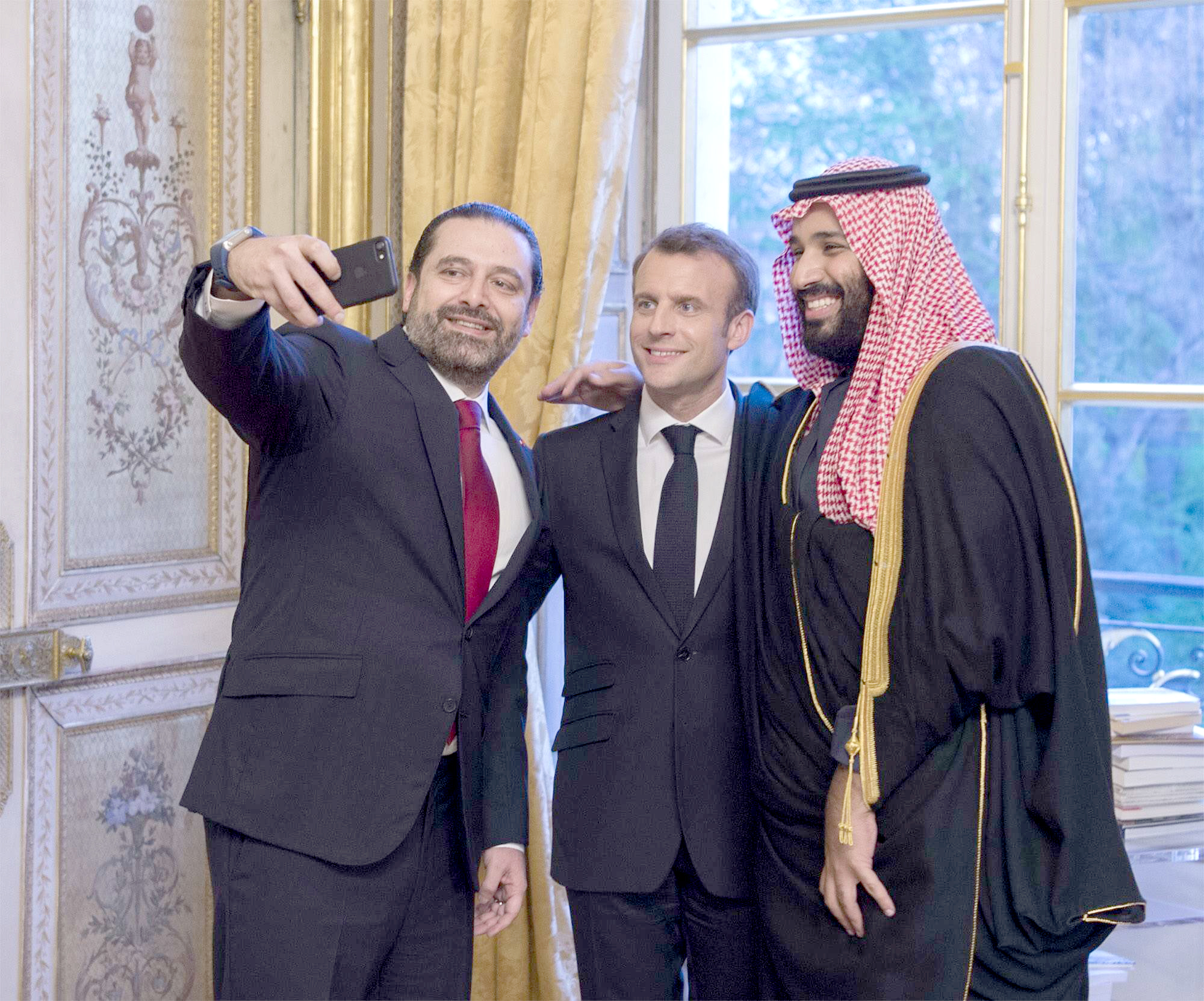 French President Emmanuel Macron (C) and Saudi Crown Prince Mohammed bin Salman bin Abdulaziz (R) pose next to Lebanese Prime Minister Saad Hariri in Paris, on April 10. (AFP)