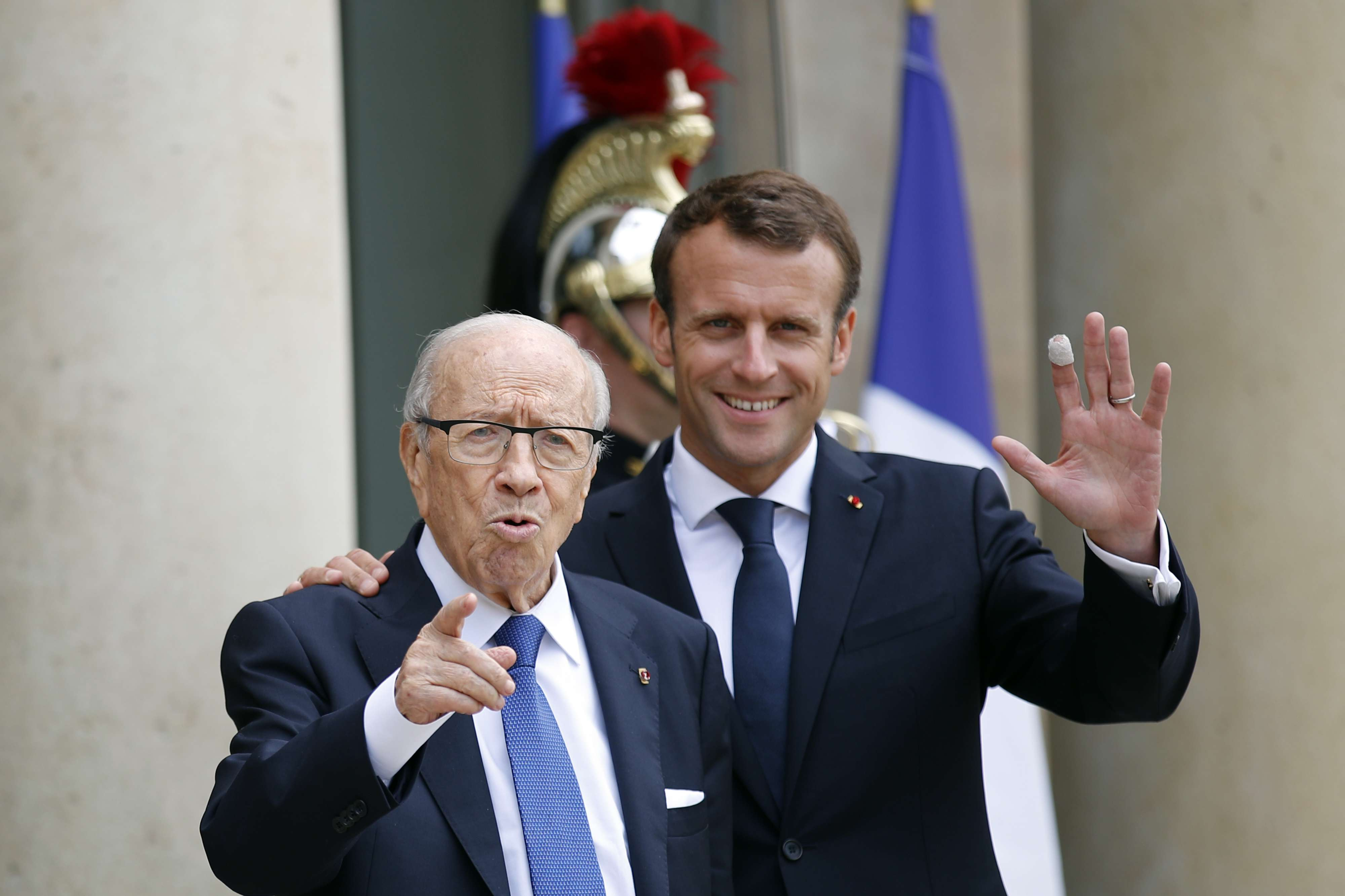 Priority issue. French President Emmanuel Macron  (R) and Tunisian President Beji Caid Essebsi after an international conference on Libya in Paris, on  May 29.(AP)