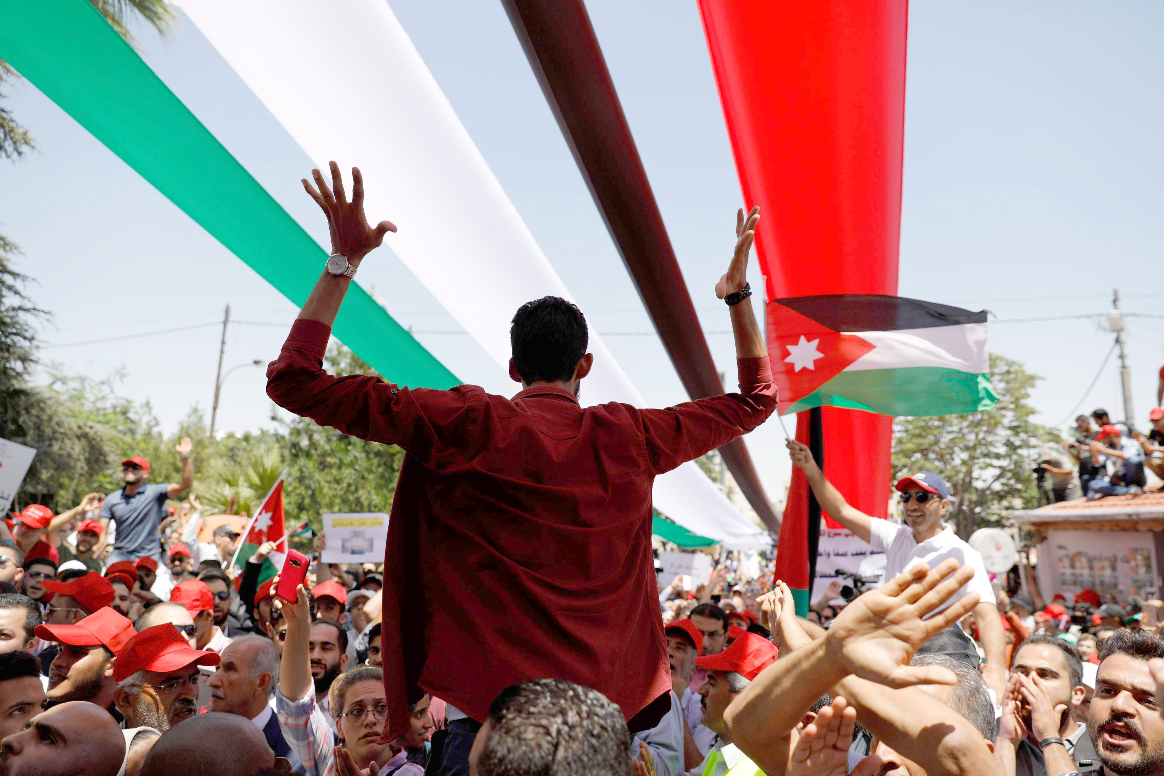 Jordanian protesters chant slogans during an anti-austerity rally in Amman, on June 6. (AFP)