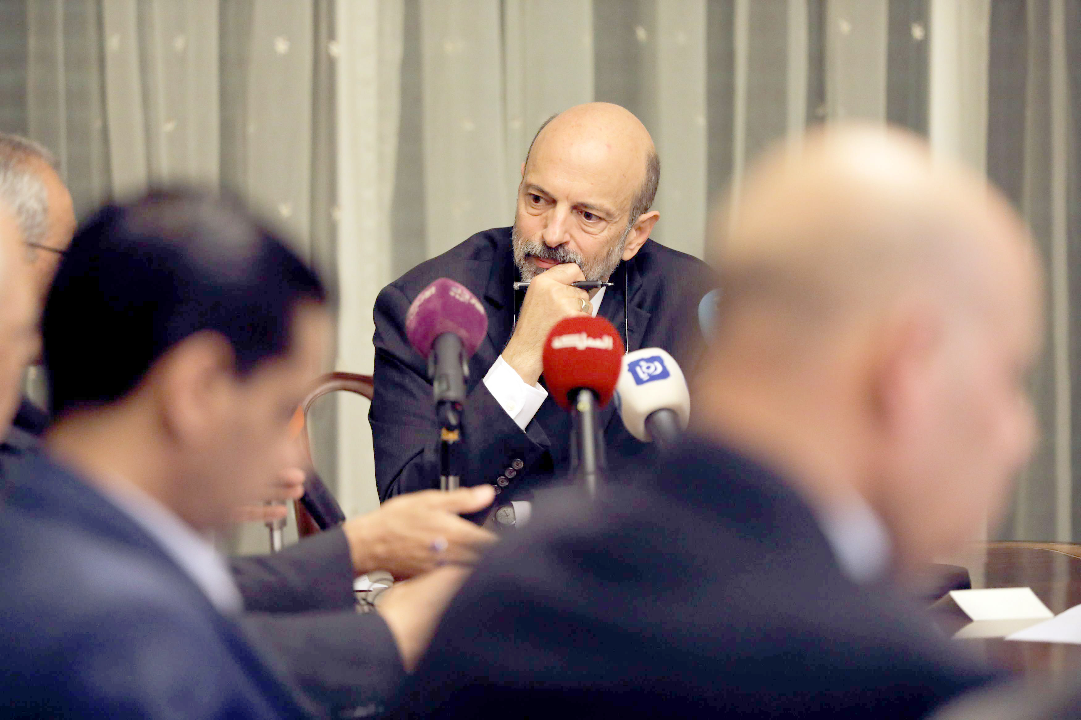 Jordan's designated new Prime Minister Omar Razzaz meets with union leaders in Amman, on June 7. (Reuters)