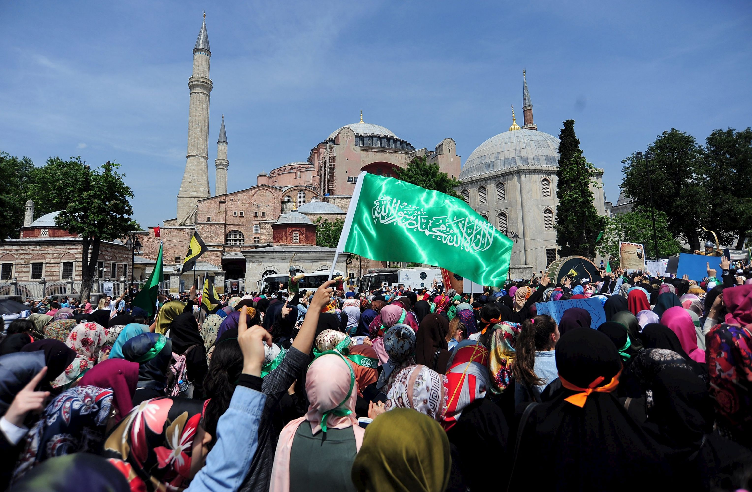 A file picture shows supporters of the Muslim Brotherhood shouting slogans during a rally in front of the Hagia Sophia museum in Istanbul. (Reuters)