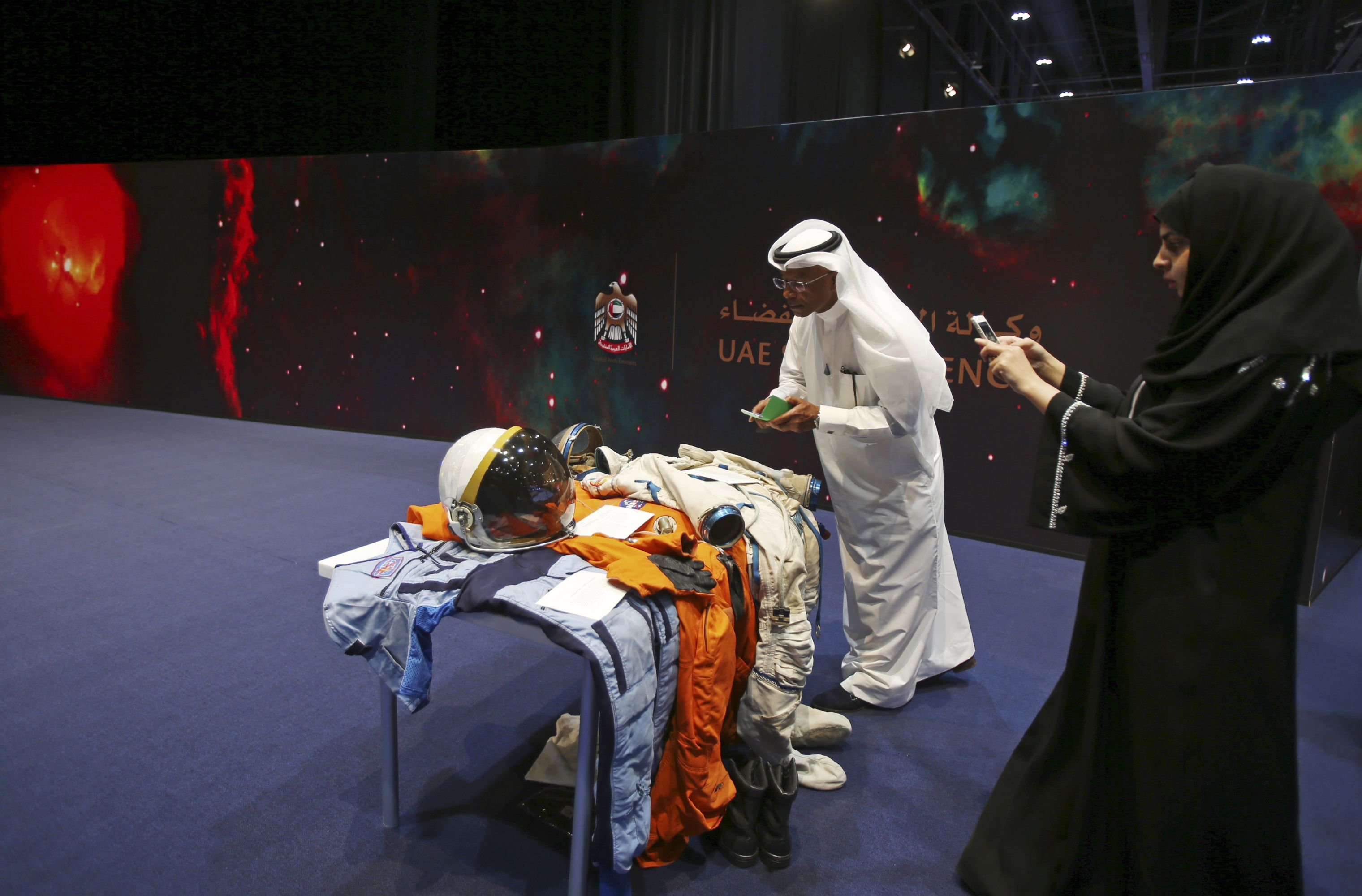 Beyond exploration. Emirati visitors take photos at a temporary space museum in Abu Dhabi.         (AP)