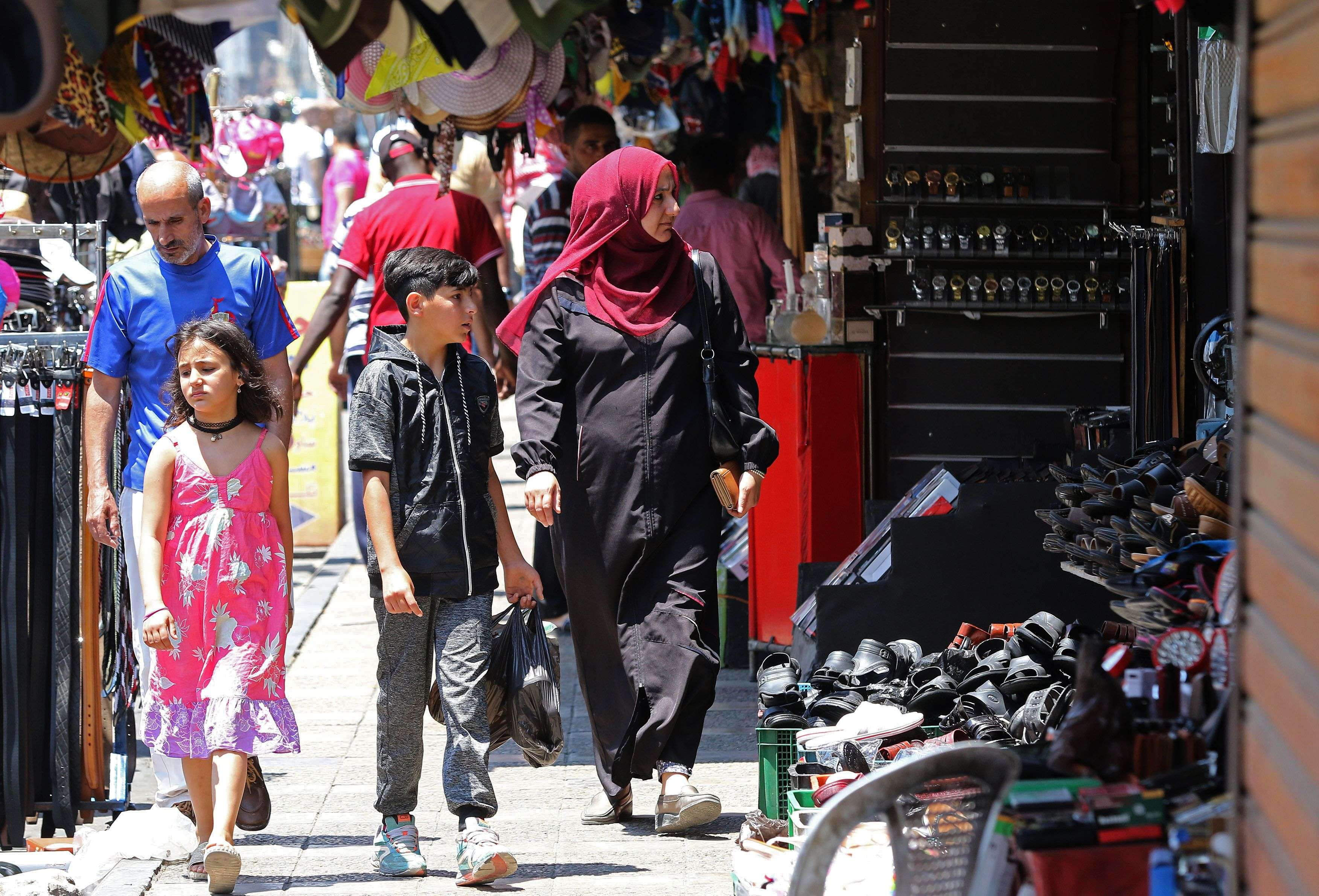 Hoping for better days. People stroll in a traditional market in downtown Amman.(AFP)