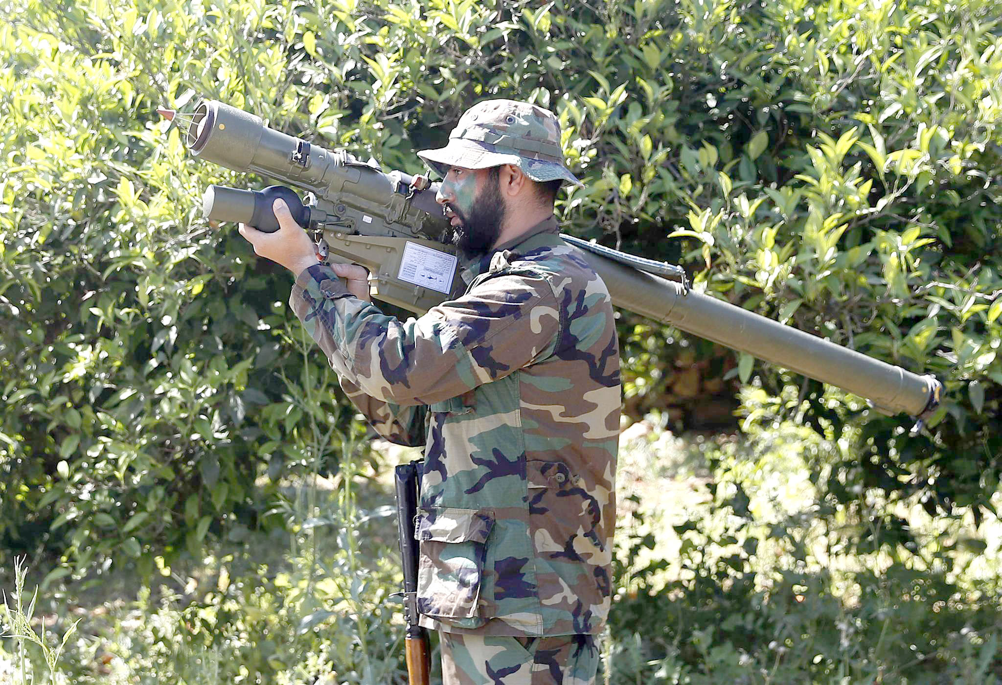 A Hezbollah fighter holds an Iran-made anti-aircraft missile launcher on the border with Israel in Naqoura. (AP)