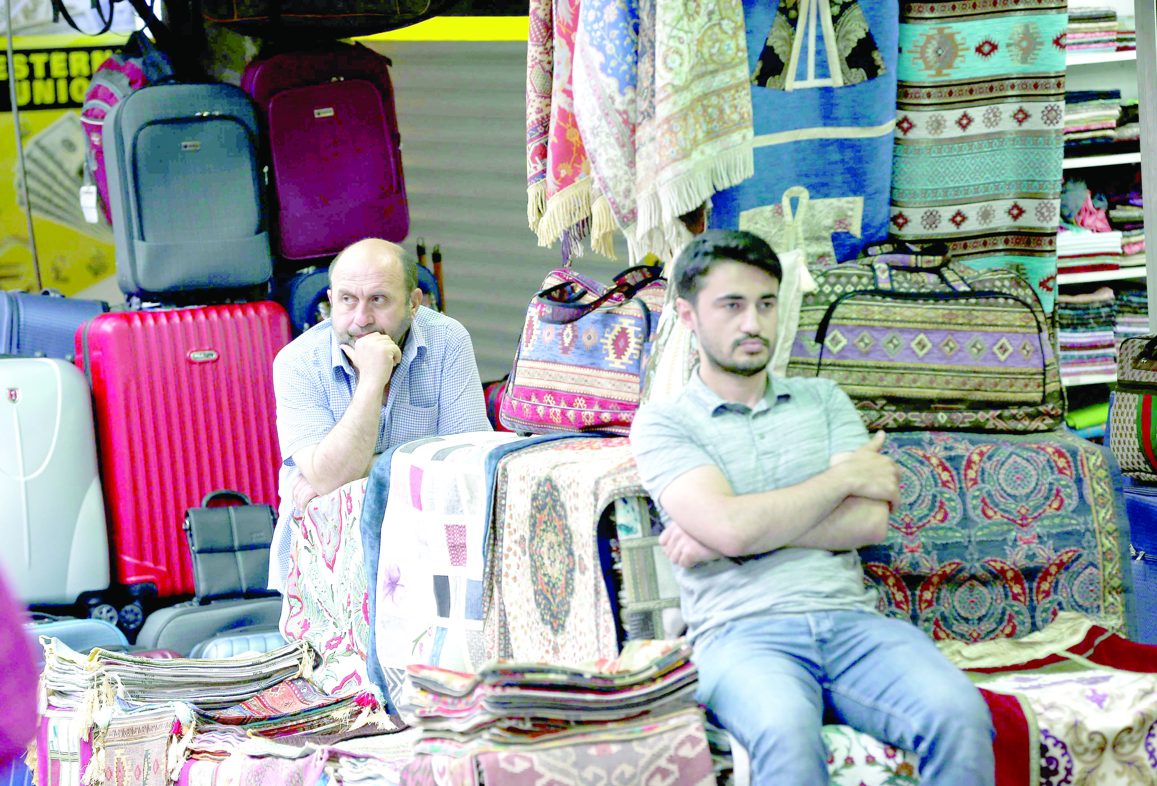 Inescapable hardships. Shop owners wait for customers at their stall in Istanbul's Grand Bazaar, on May 25. (AP)