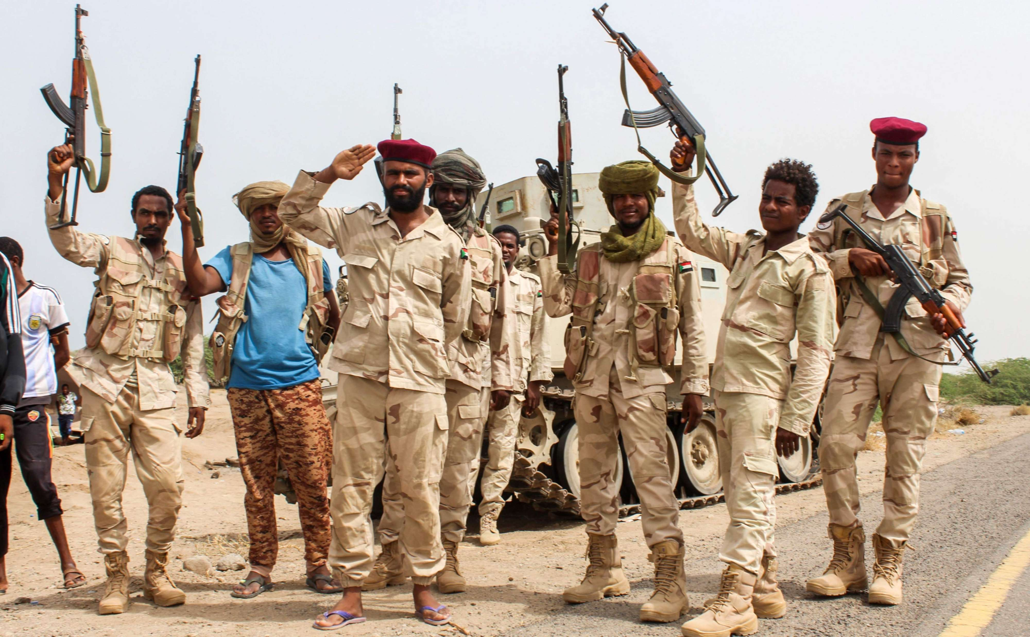 Sudanese soldiers fighting alongside Yemen's pro-government forces gather on the side of a road near Al-Jah, about 50km south-west of Hodeidah, on June 22. (AFP)