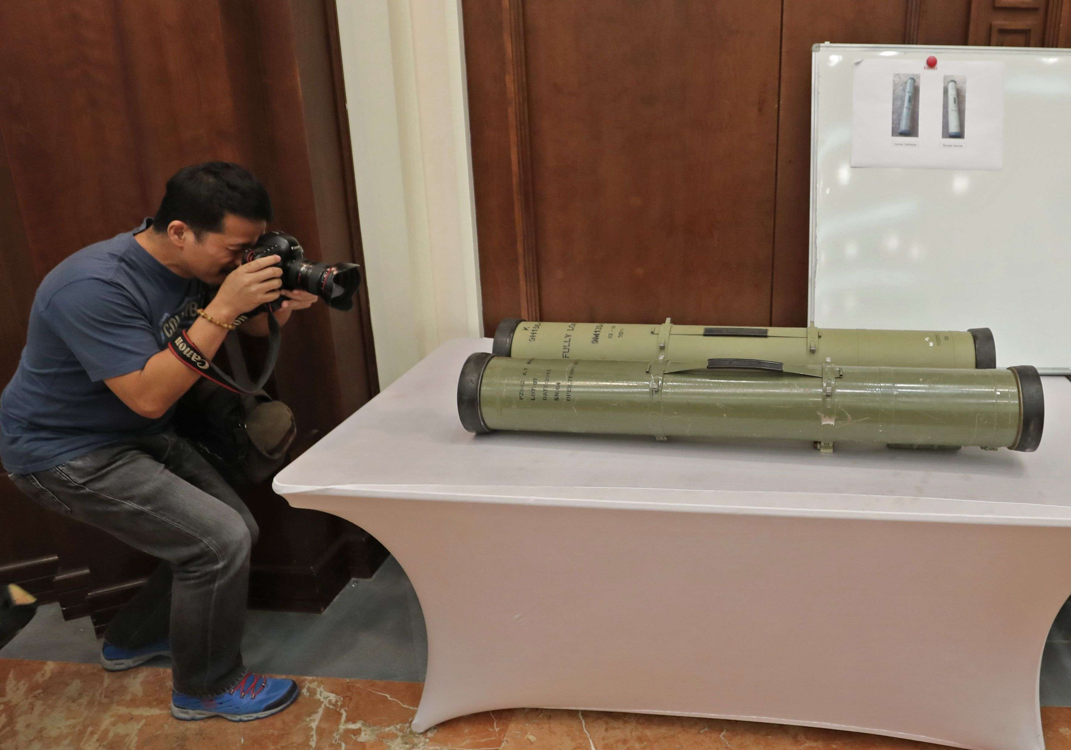 A photographer takes a picture of  an Iranian-made anti-tank missiles. (AFP)