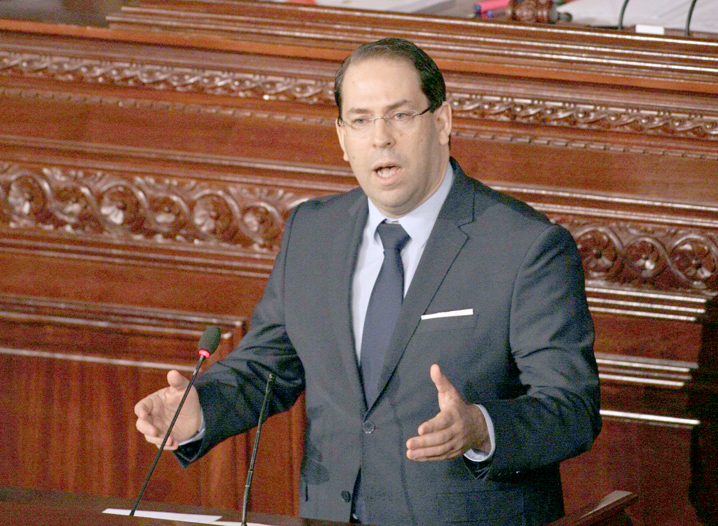 Tunisian Prime Minister Youssef Chahed addresses parliament amid calls to reshuffle government, last March.  (AFP)